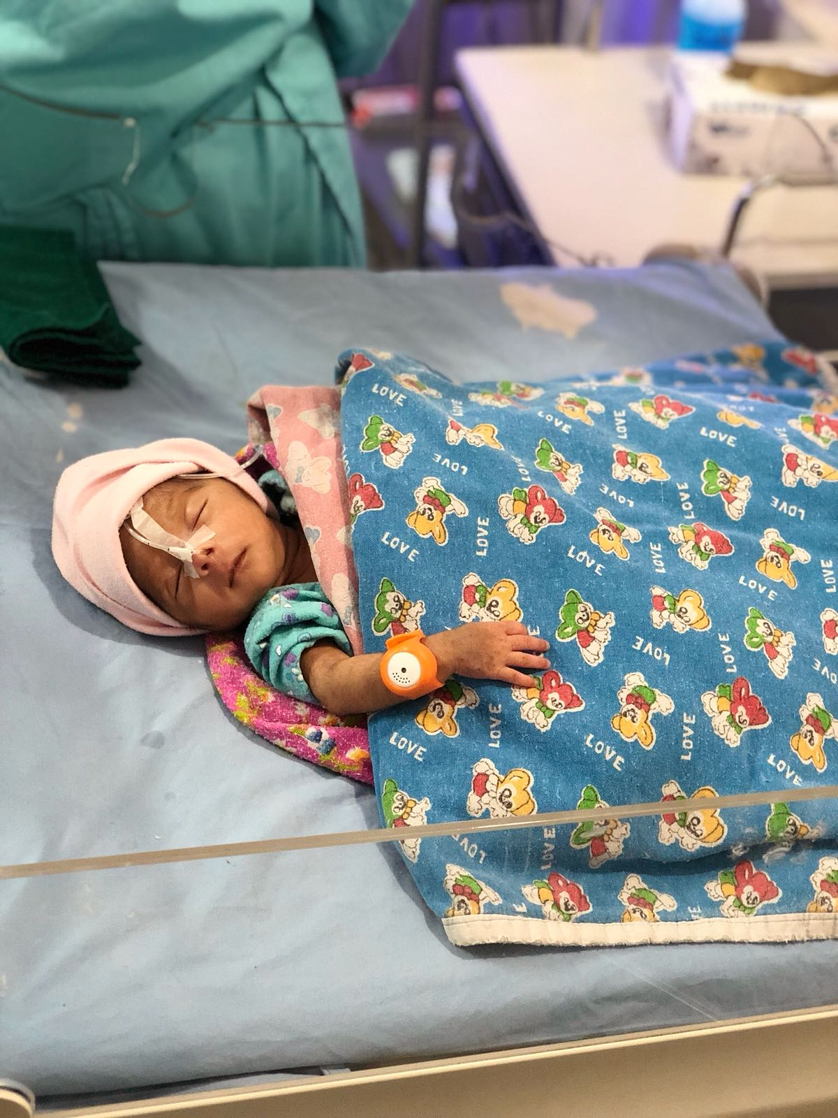 A baby wearing a BEMPU TempWatch in a hospital in Bangladesh.