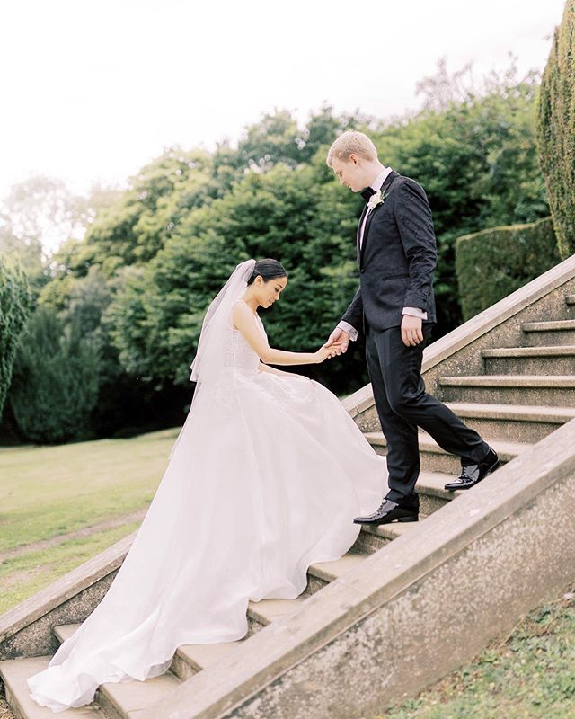 It's couples like Priscilla and Jonathan who make me so grateful to be a wedding photographer! These two got married at the weekend at Hunton Park near London and it was such an elegant, beautiful day in the company of people who had travelled far and wide to celebrate with the happy couple. ⠀⠀⠀⠀⠀⠀⠀⠀⠀ Venue: @huntonparkhotel  Florals: Alexandra's Florists Cake: Cakes by Jackie Make-up: @hannahorganmakeup  Hair: @lovemeknot_  Dress: @pronovias  Jewellery: @77diamonds