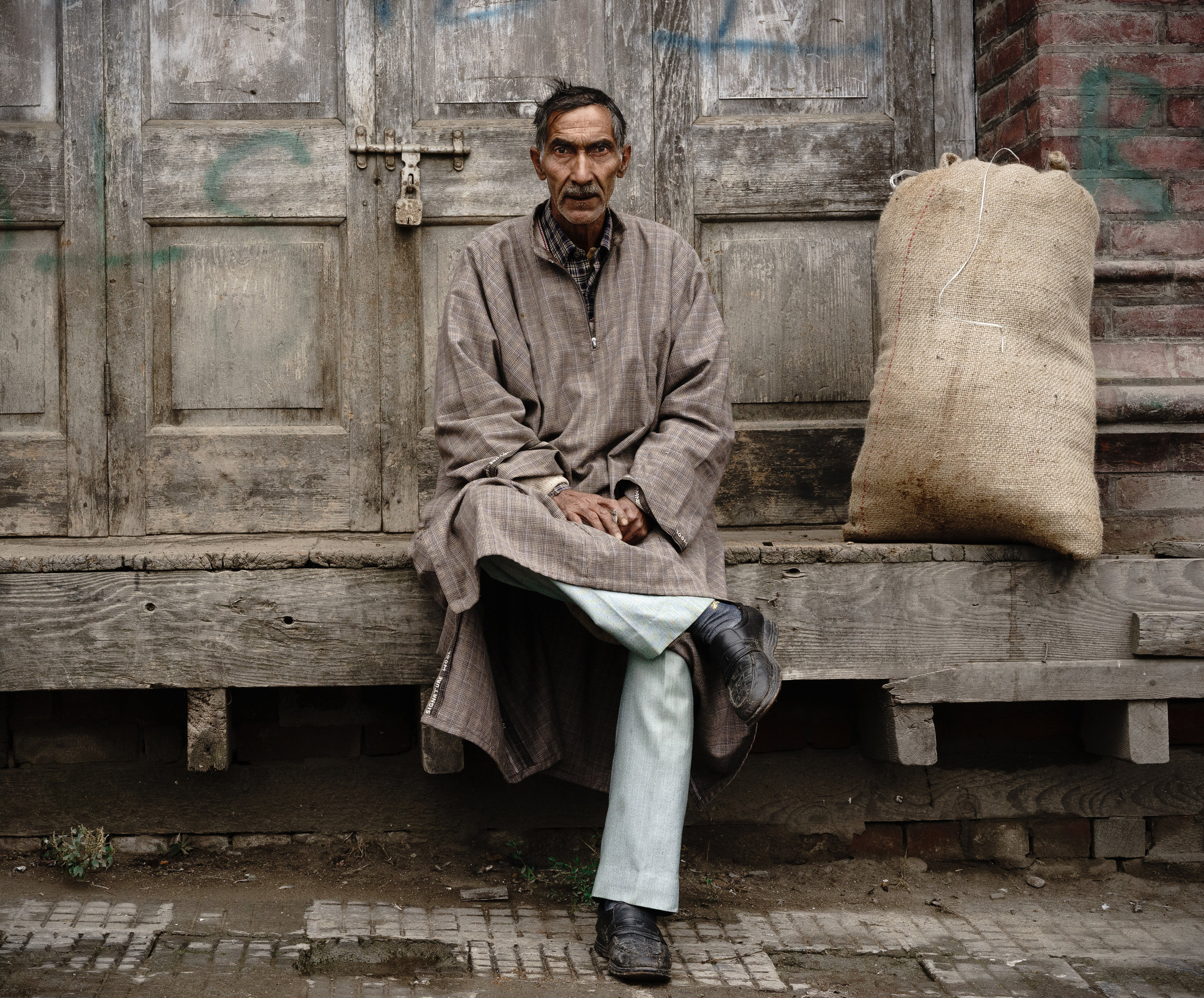 A man sits.
