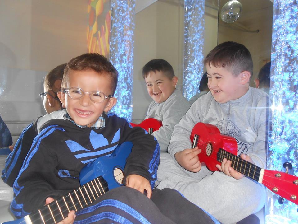 Kosovo boys with guitars.jpg