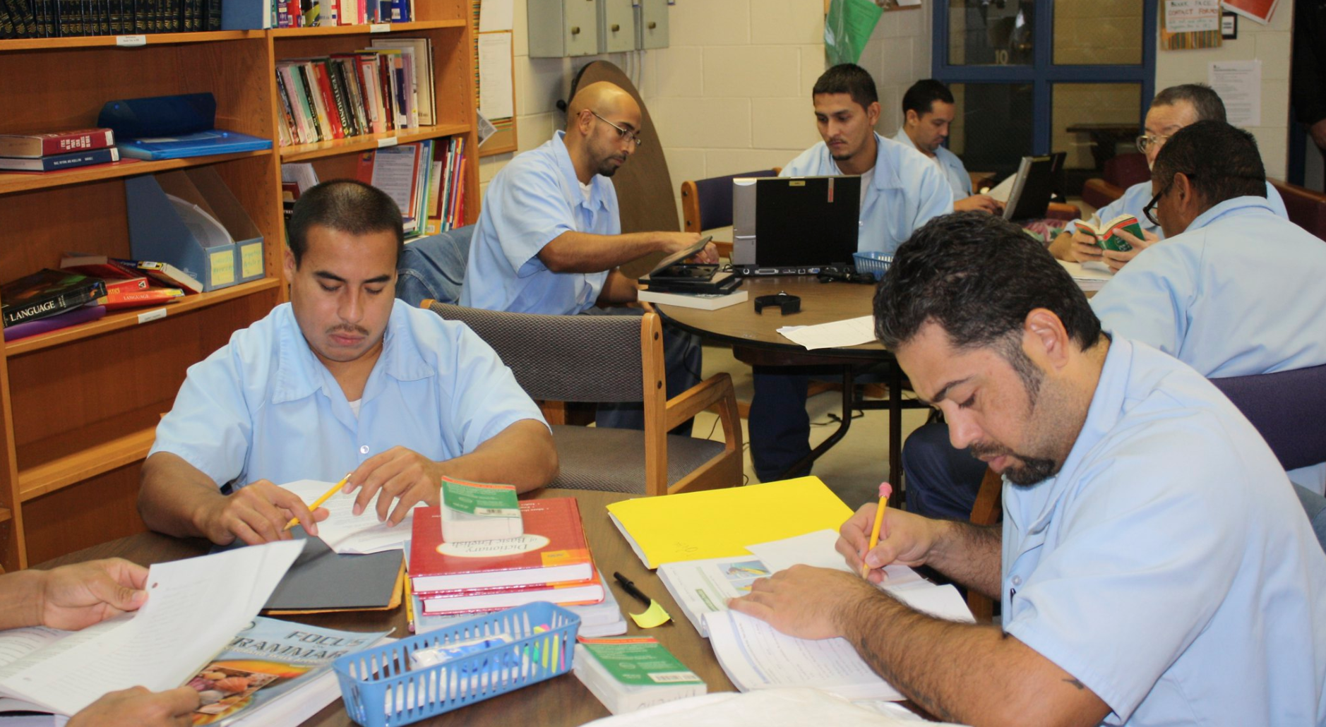 - Incarcerated men working inside the Education Justice Project library at the Danville Correctional Center