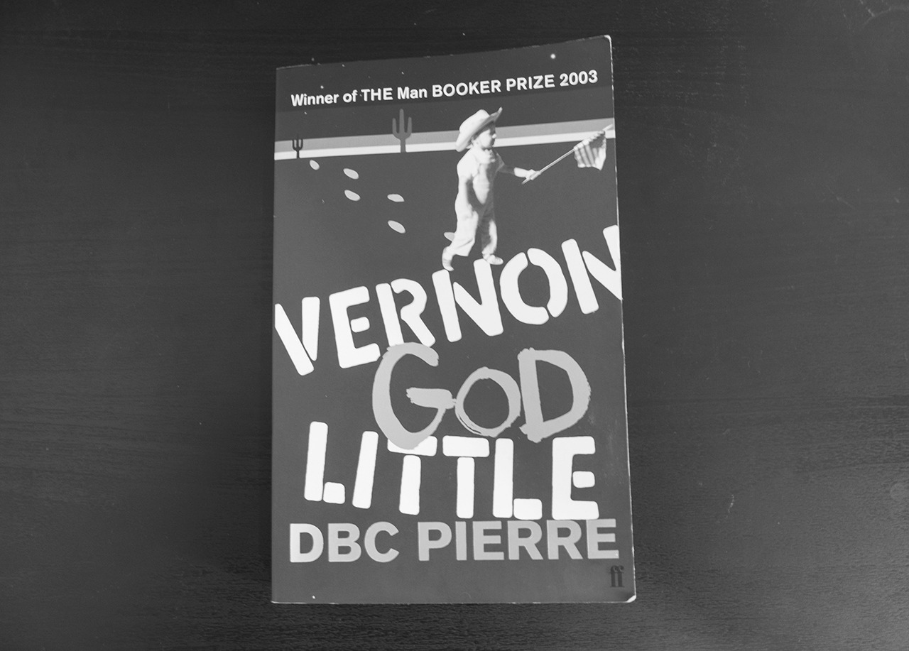 """Vernon God Little   by DBC Pierre     """"Those boys have seen some shit- hell, all they sing about is the shit they've seen; you just know they woke up plenty of times on a wooden floor somewhere, with ninety flavors of trouble riding on their ass.""""    Just finished this. Loved it. If you like a dark, biting satire that is both hilarious and profound,  have a read . You won't be disappointed."""