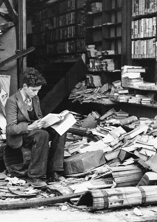 London bookshop destroyed by an air raid, October 8, 1940    Wonder what he's reading.   ( via )