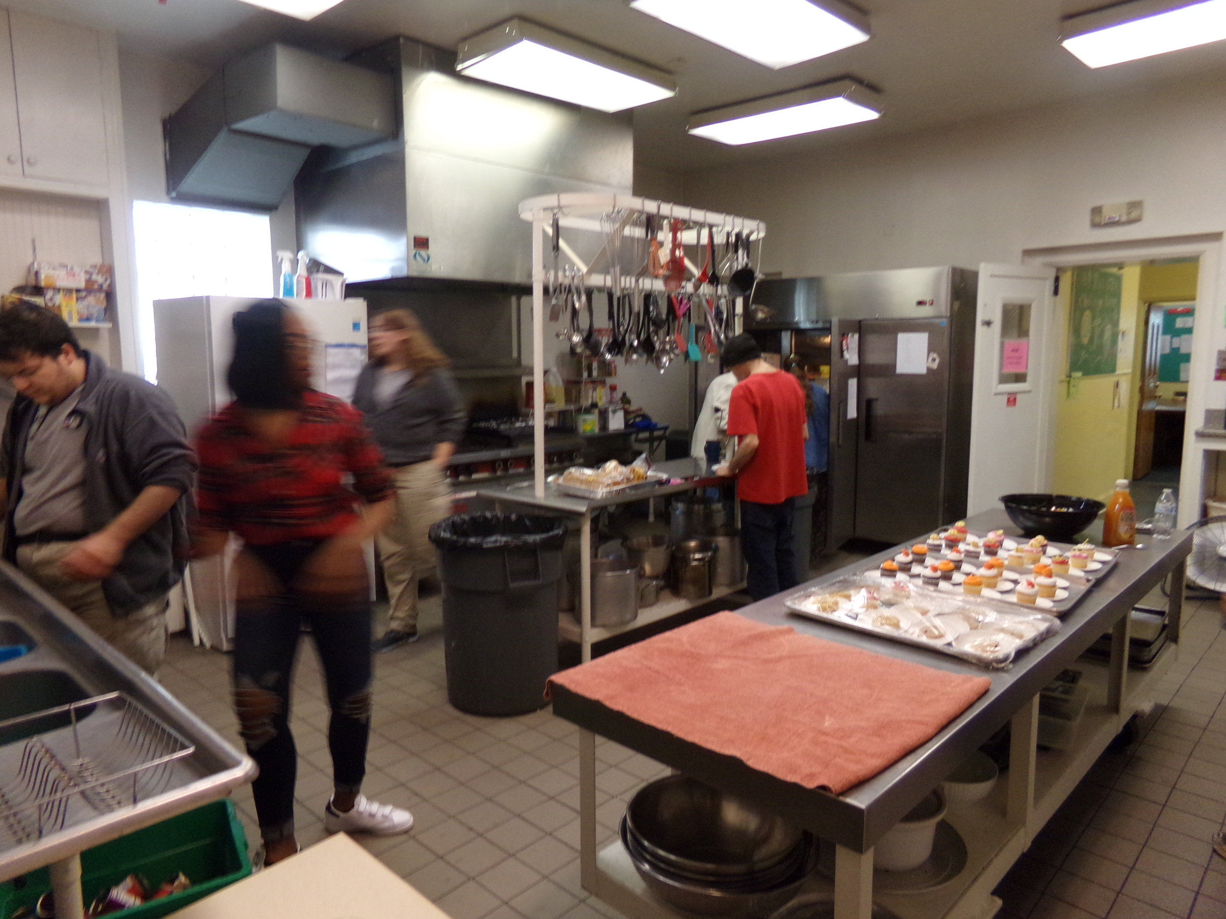 Community members, VISTA and NCCC volunteers, and church staff prepare for community lunch, held Monday-Thursday, noon-12:30pm.