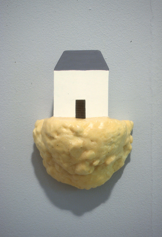 fra serien  Hjemmet og vi    objekt ca (30x25x8)cm, kartong, fugeskum, voks, maling, 1997