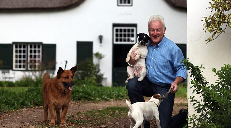 Winemaker Ken Forrester, at home with his dogs in South Africa. Photo Credit: South African Country Life