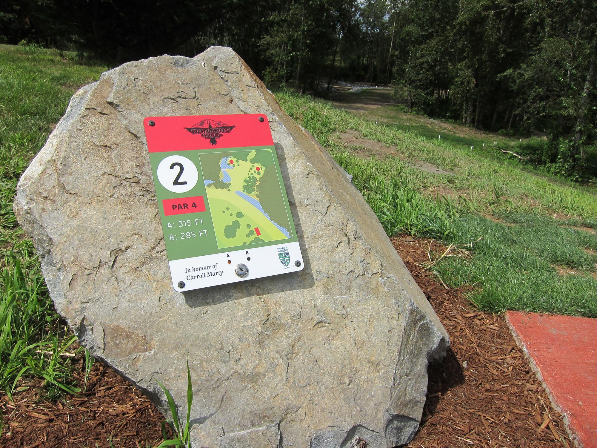 Tee sign at Raptors Knoll disc golf course, Aldergrove, BC.
