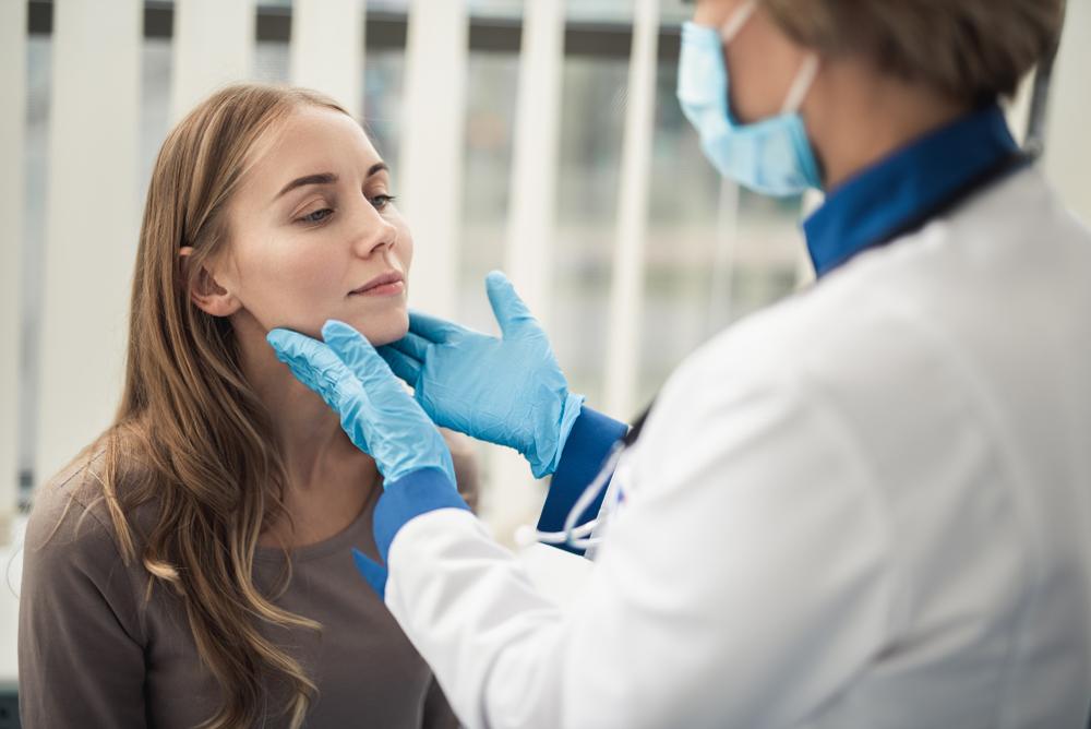 ent doctor examining tonsillitis.jpg