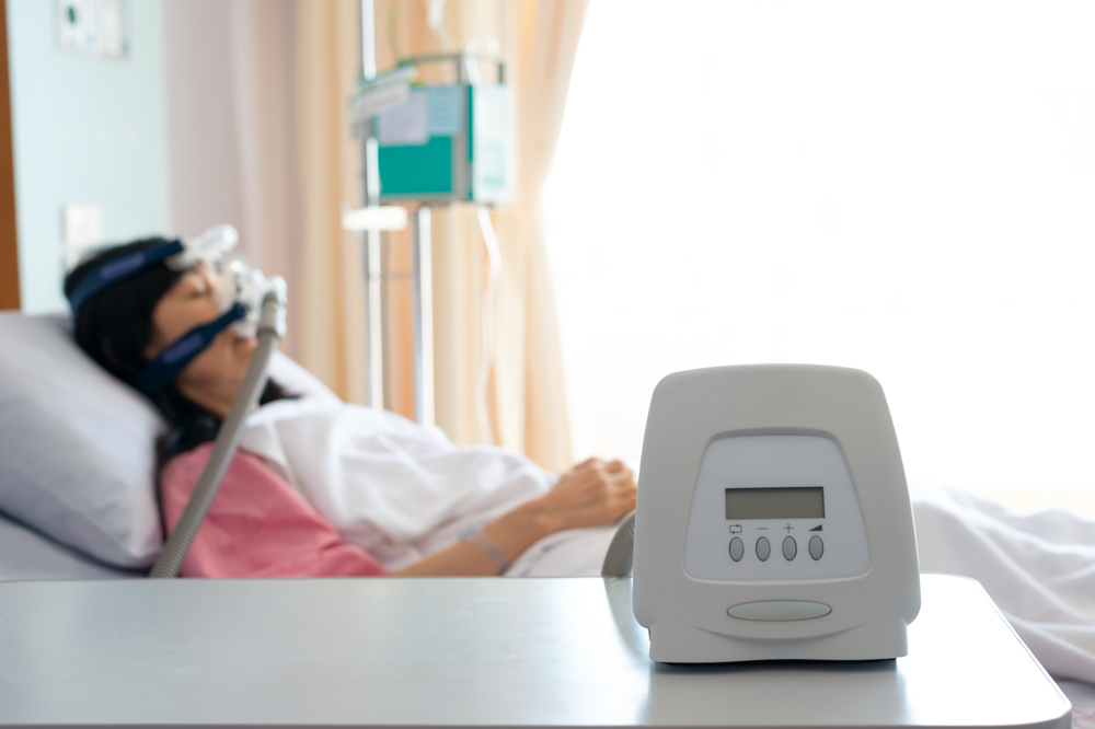 CPAP Machine And Patient in the background
