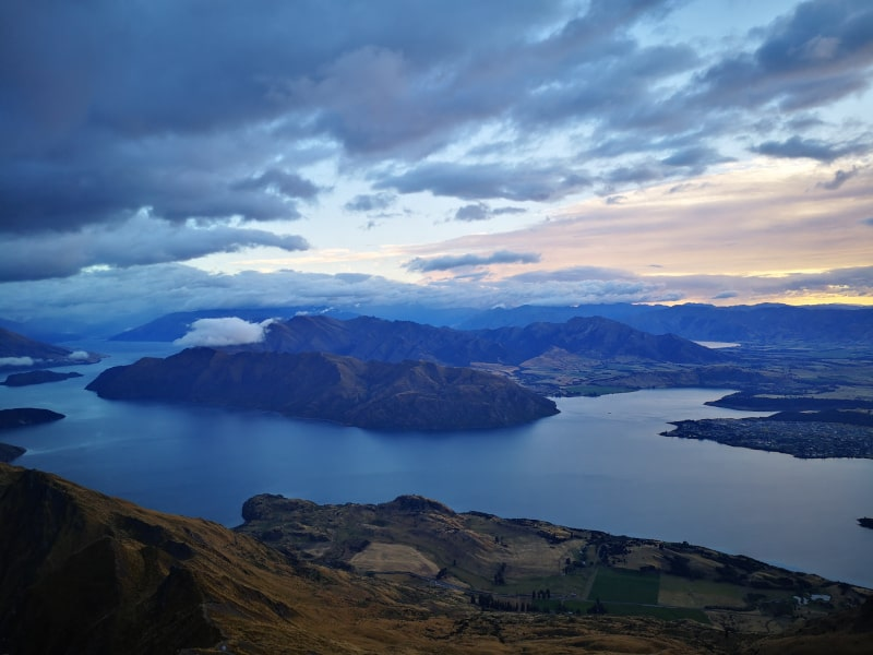 The view from the top of Roys Peak! That's Wanaka to the right of the shot. It's another must do for your South Island New Zealand trip.