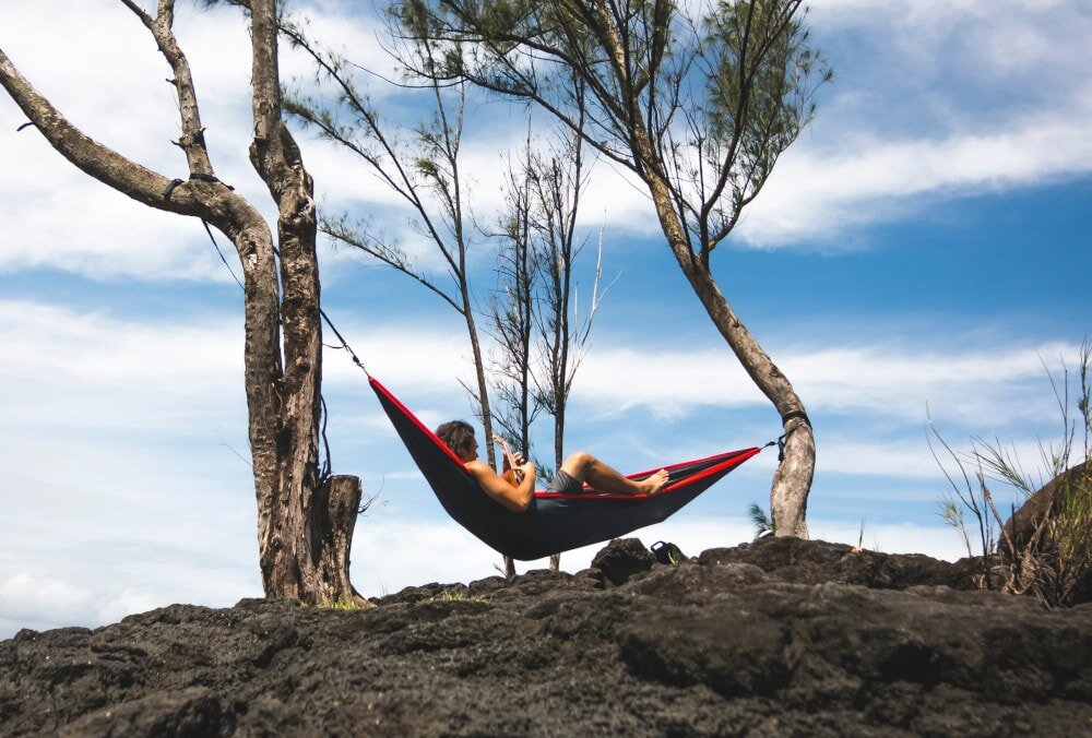 You're fine without a bug net when you're chilling out in a hammock during daytime. But bug nets for hammocks are all-important once night turns to day.