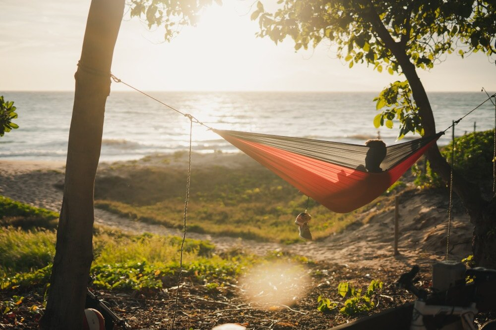 Hammocks are epic. I mean, just look at this photo! It doesn't get much better. But you're sure to regret it if you don't take along some hammock bug netting for night-time.
