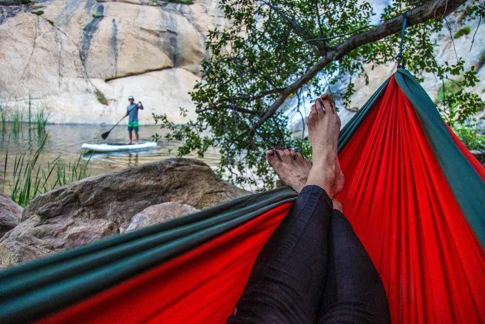 A quality rain tarp for hammock camping makes all the difference in bad weather.