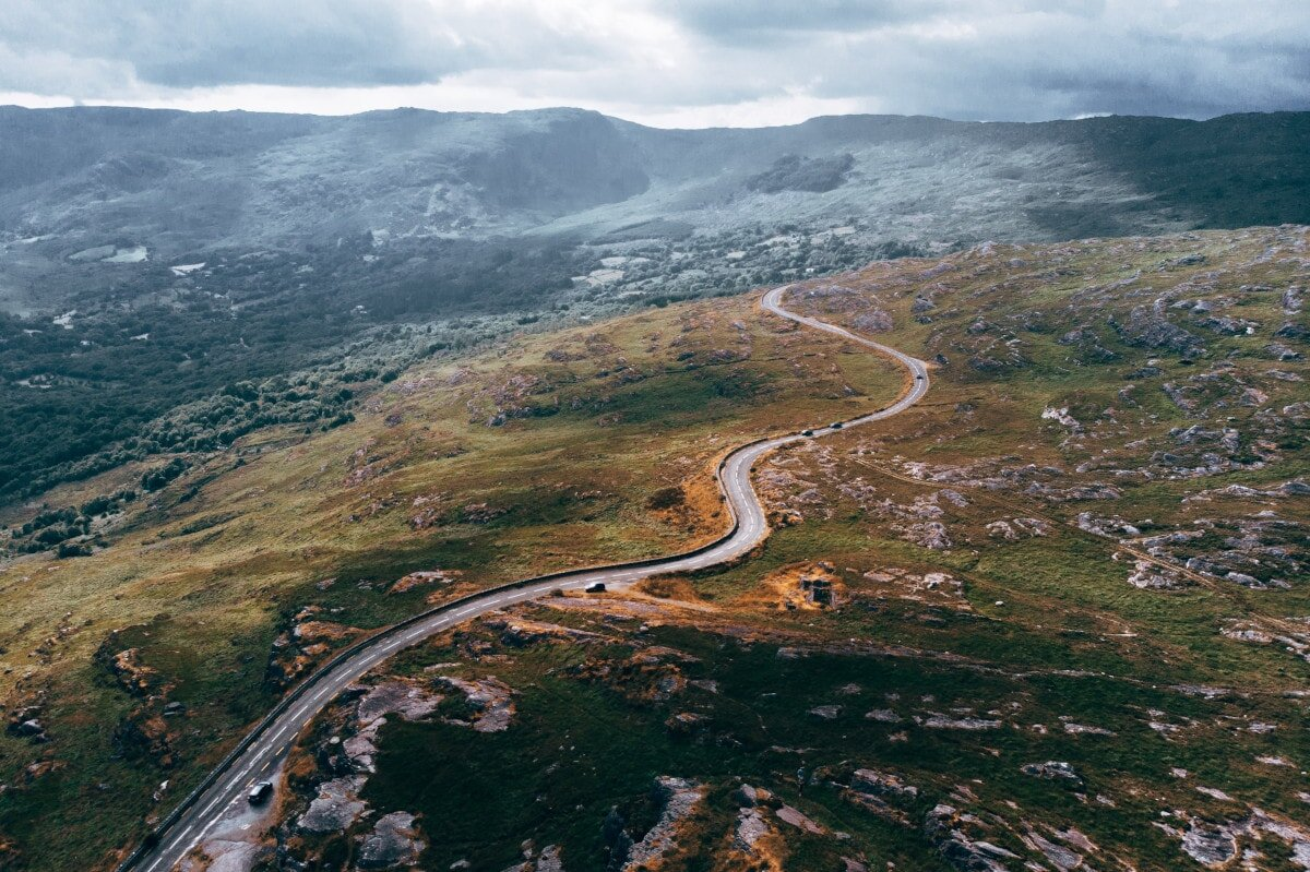 Funny quotes on road trips are often inspiring too- just like this picture of a stunning road curling, curving, and unfurling before you.