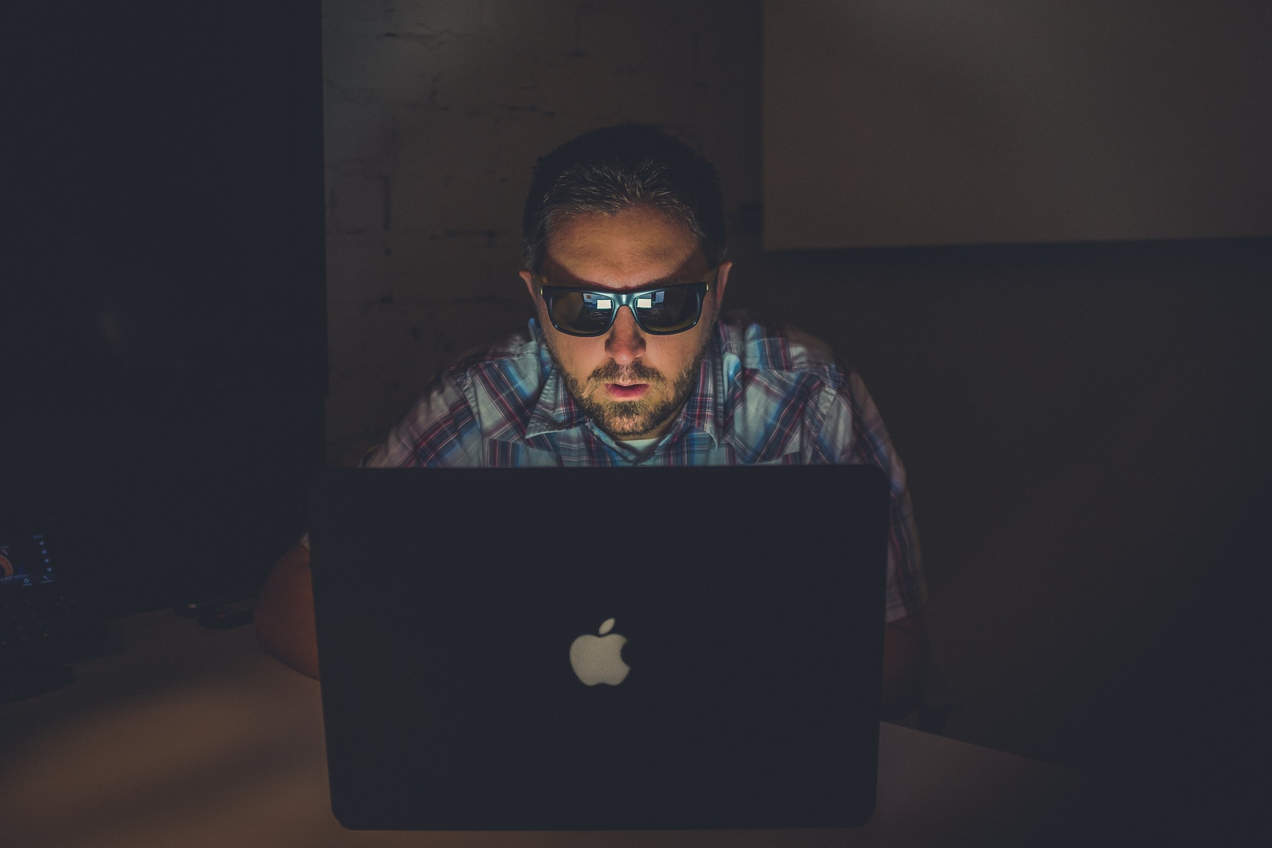 Wearing sunglasses in a dark room while all type-y click-y, the hallmark of a hacker. (Photo by    NeONBRAND    on    Unsplash   )