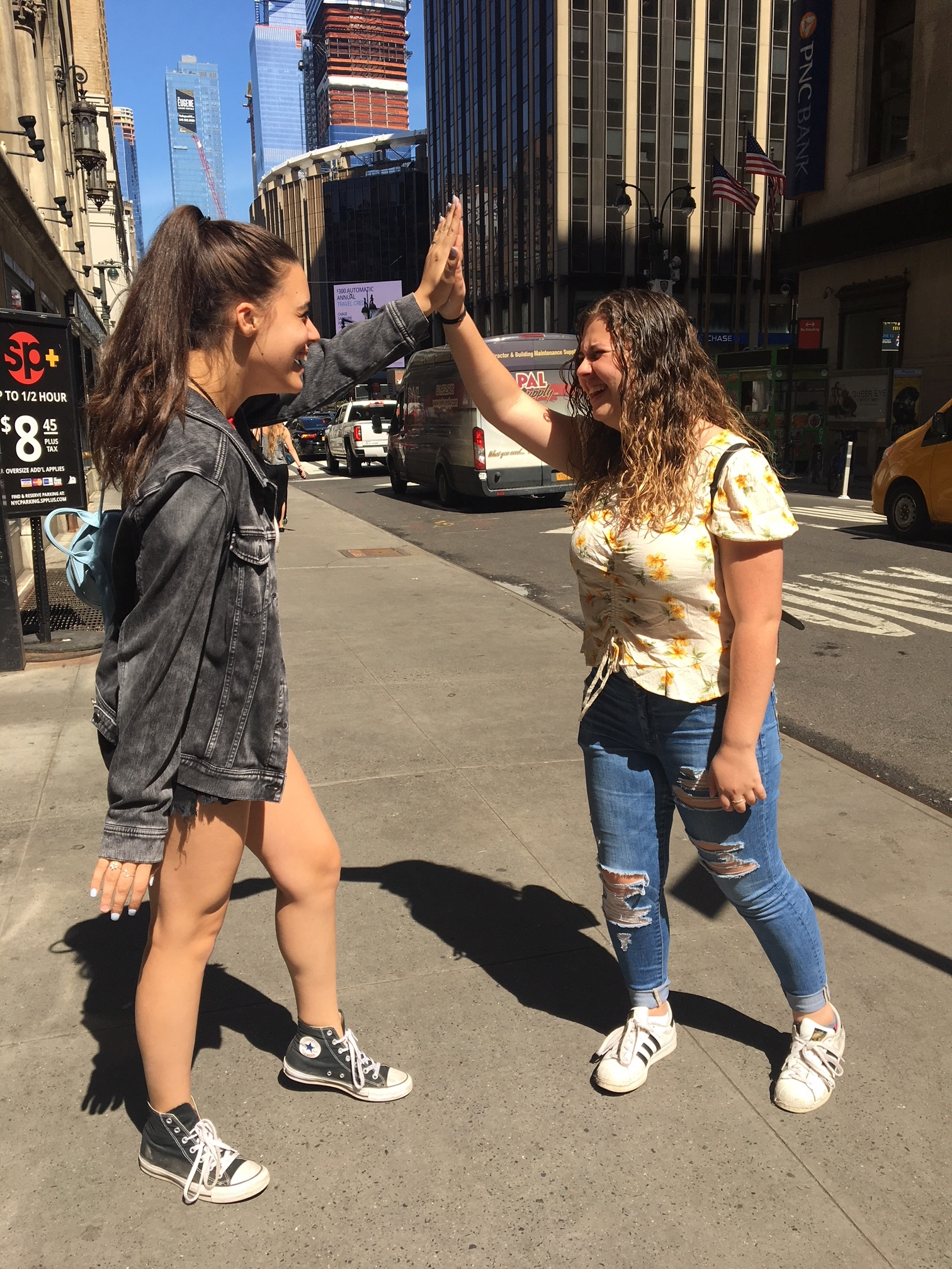 "Andrea Pena & Sawyer Garrity– songwriters of the #MDSstrong anthem ""SHINE""– high five in Times Square."