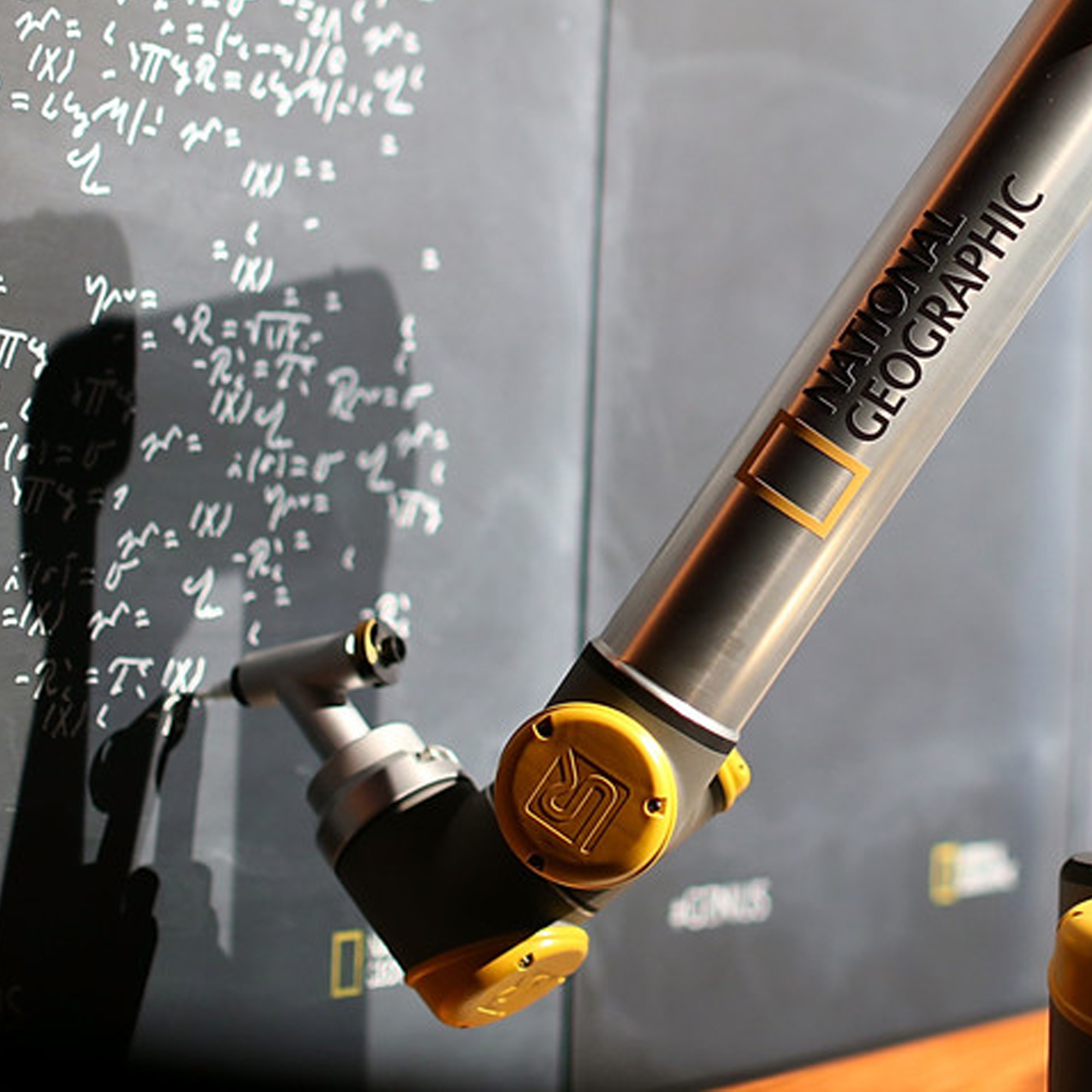 NATIONAL GEOGRAPHIC CHALKBOARD - A chalkboard with a robotic arm sketches selfies using Einstein's handwriting and equations.