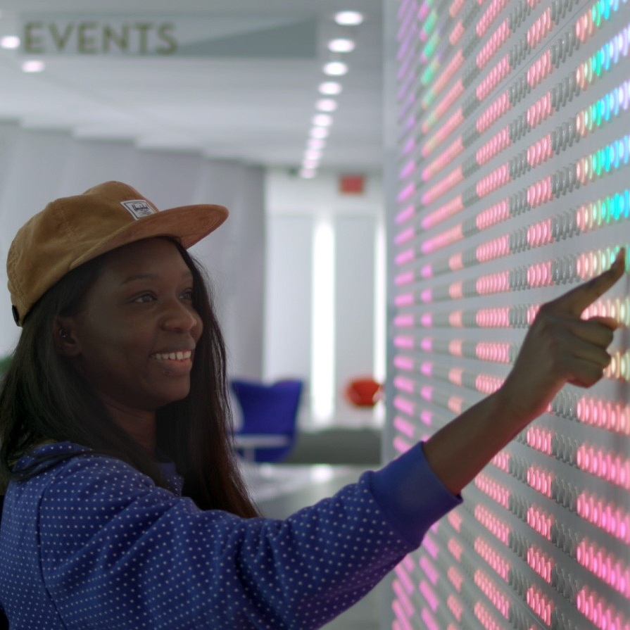 Googleanypixel - An interactive wall display made up of arcade buttons that act as pixels and respond to touch.