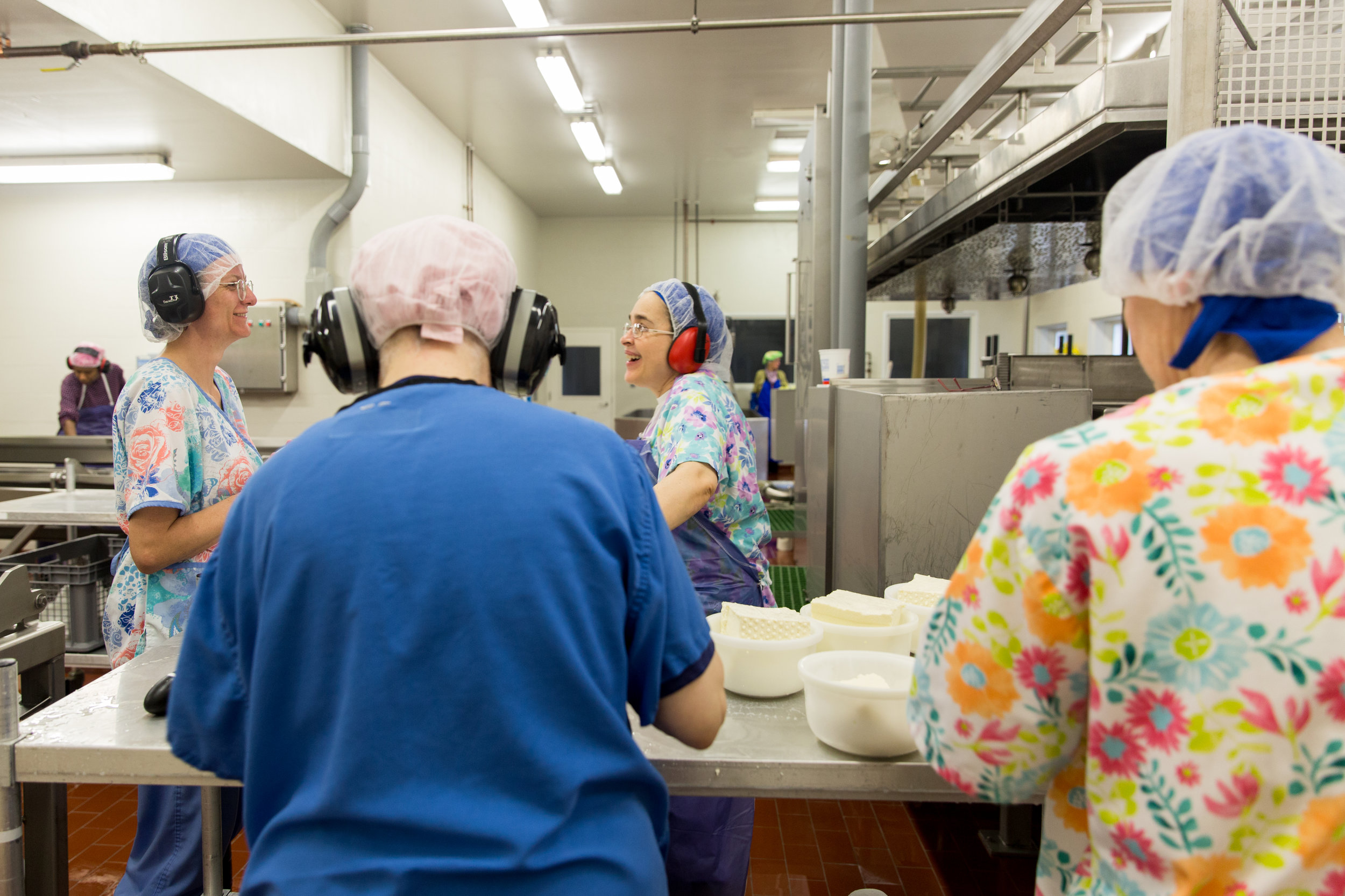 The sisters squeeze water from the gouda cheese before weighing Thursday morning on March 21, 2019 in Crozet, Virginia. Thursday is cheese making day at the monastery and cheese process takes about 6-8 hours from start to finish.