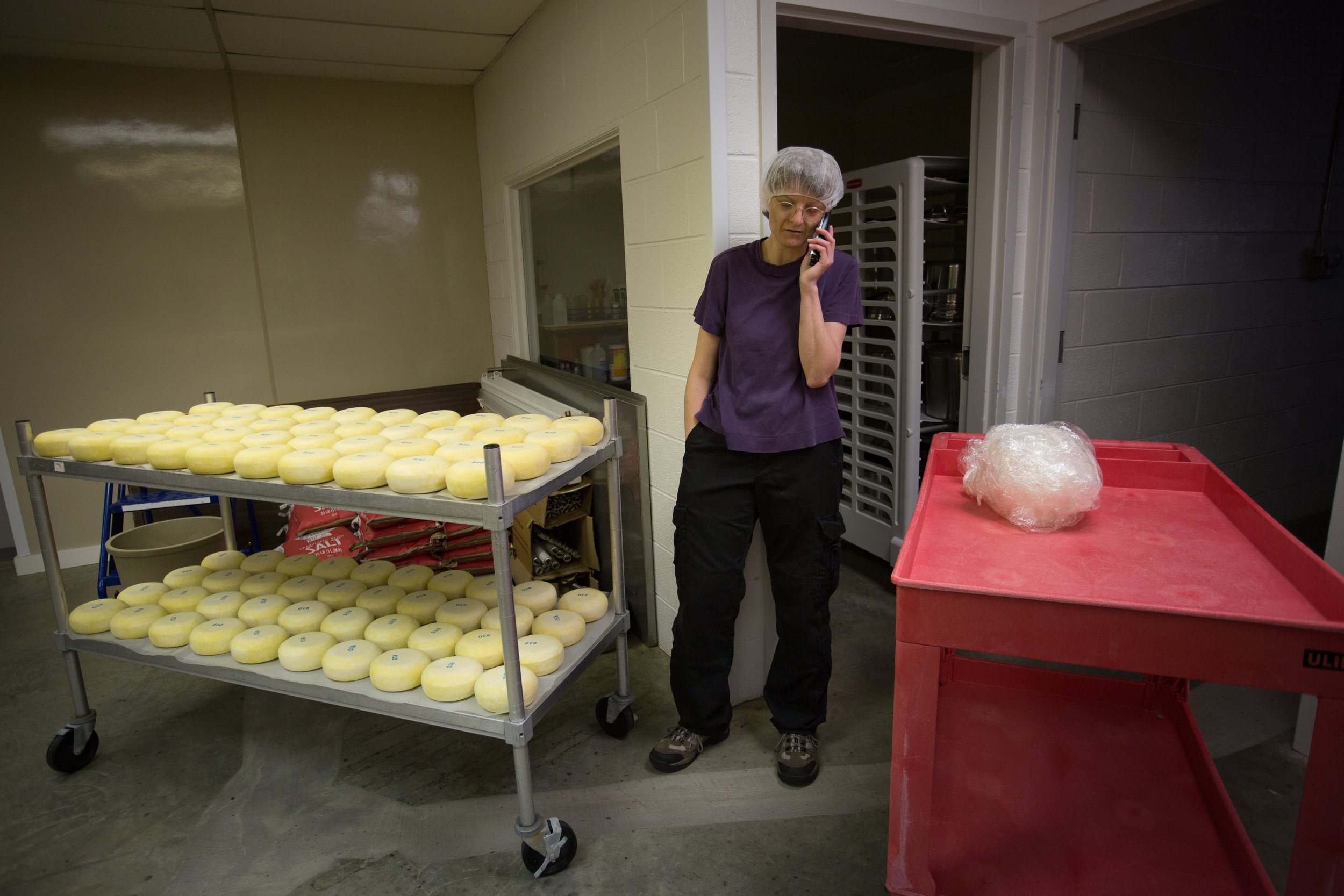 """Sister Eve Marie takes a break to call up to the church. Eve Marie prefers working in the cheese barn alone, """"I do not really need to this about what I am doing, it is easy, peaceful work,"""" Eve Marie said."""
