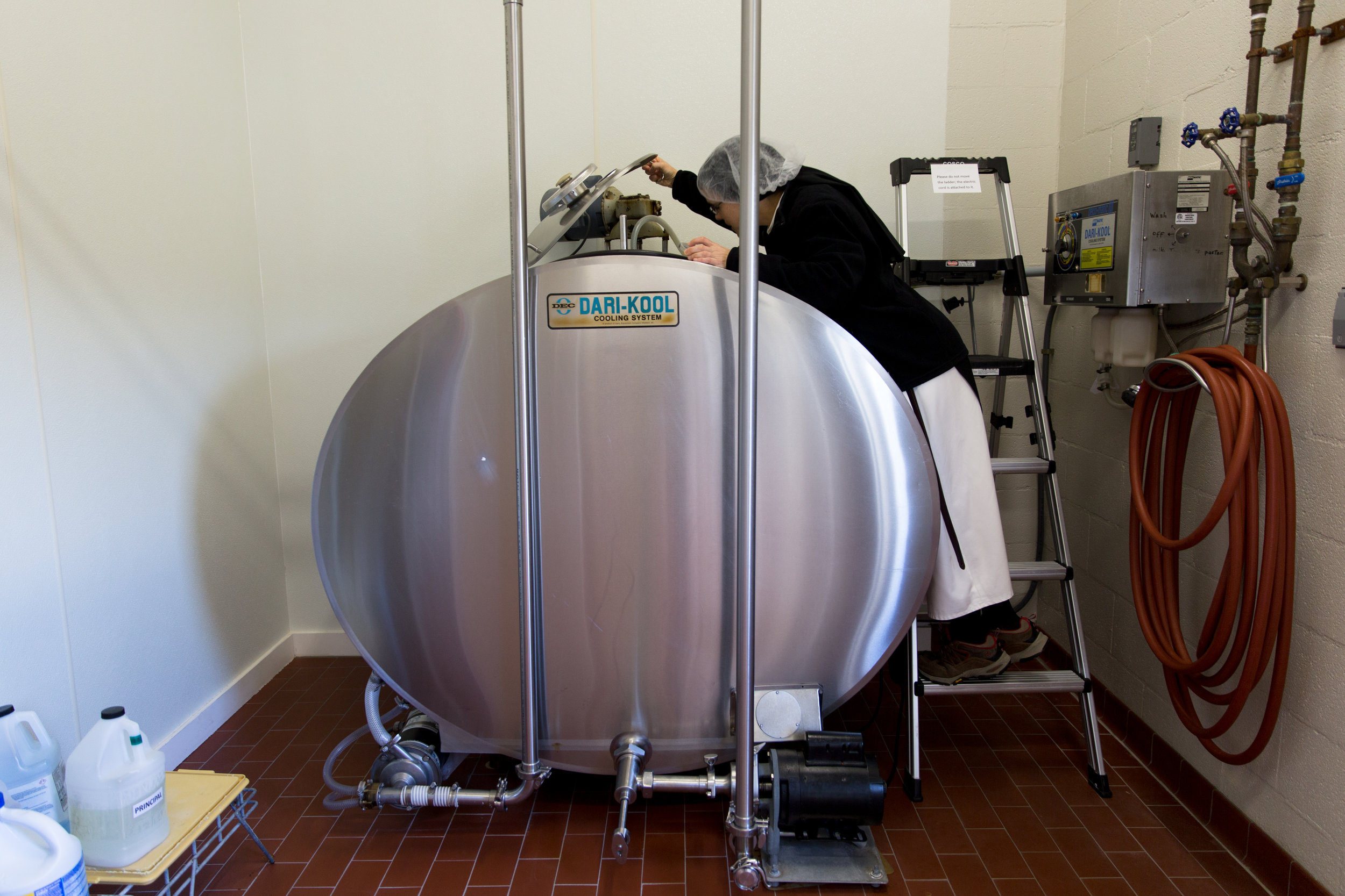 """Sister Maria checks on the empty milk tank before delivery March 4, 2019 in Crozet, Virginia. """"We get our milk delivered regularly and locally. We like to know where everything is coming from and exactly what gets put in,"""" Maria said."""