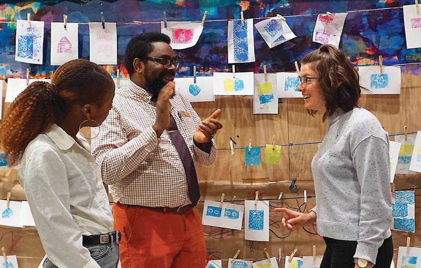 3 working professionals brainstorm in the Chicago Children's Museum Art Studio