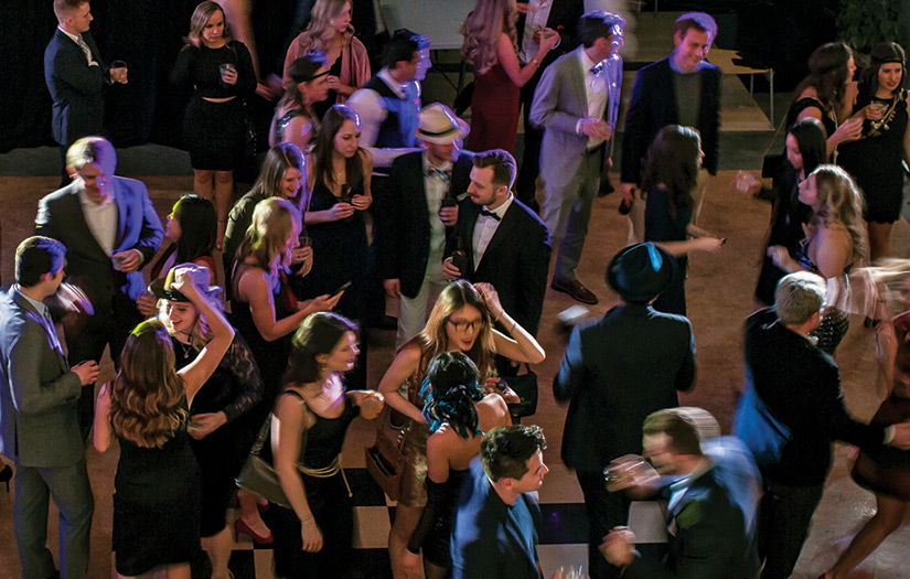 An overhead view of the museum's Great Hall filled with formally dressed partygoers dancing