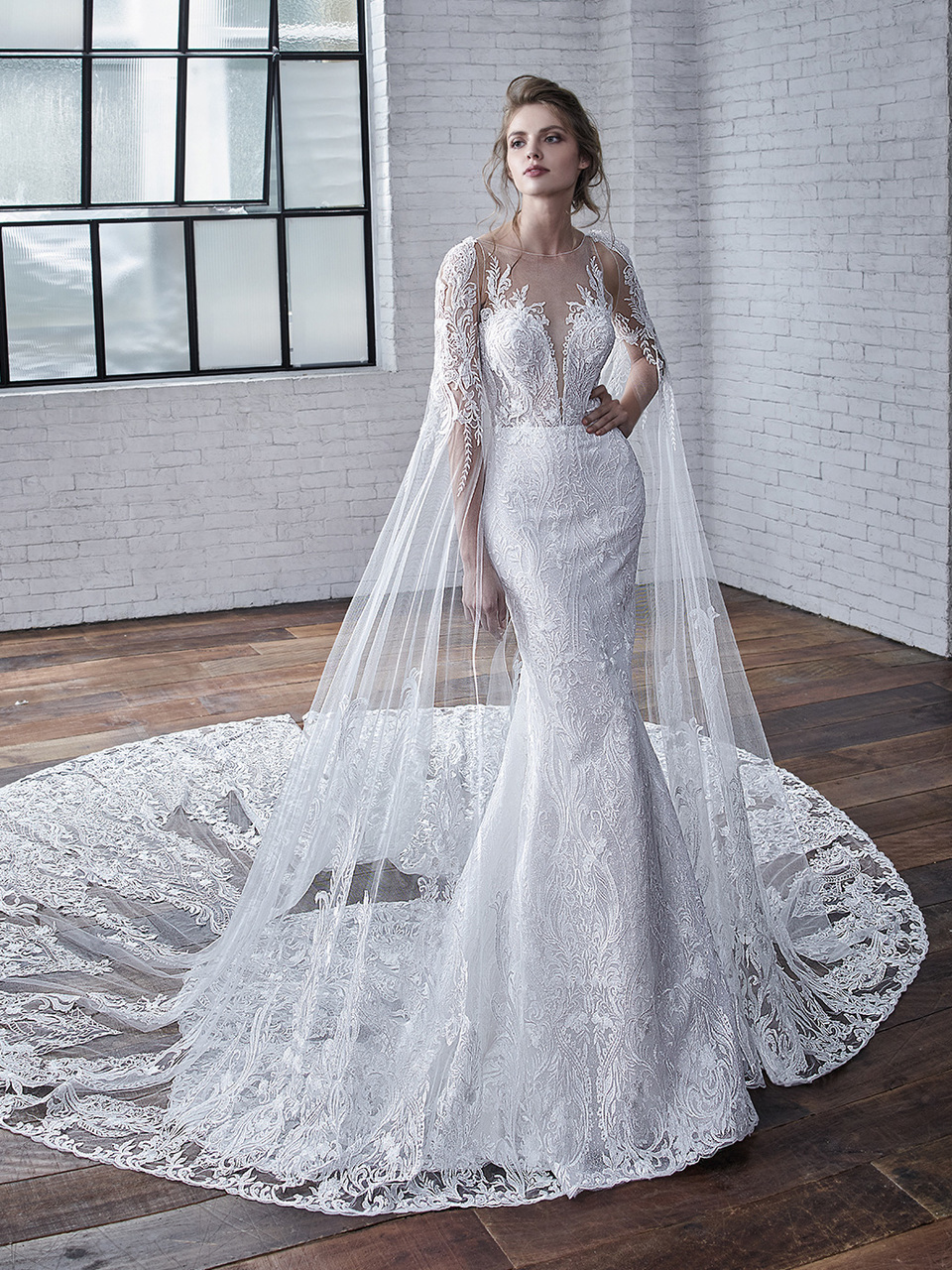 Cayenne:  There's more to this stunner than meets the eye. This is a fit and flare gown with floral embroidered lace and glitter tulle. The lace sleeves are detachable, giving brides a two-for-one look with a very unique twist.