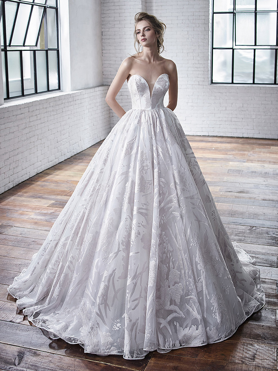 Carrington:  If you're looking for the quintessential ballgown, look no further. Carrington is a classic strapless, sweetheart ballgown. The fabric is the showstopper; a stunning burnt-out print organza, elevating an already gorgeous gown.