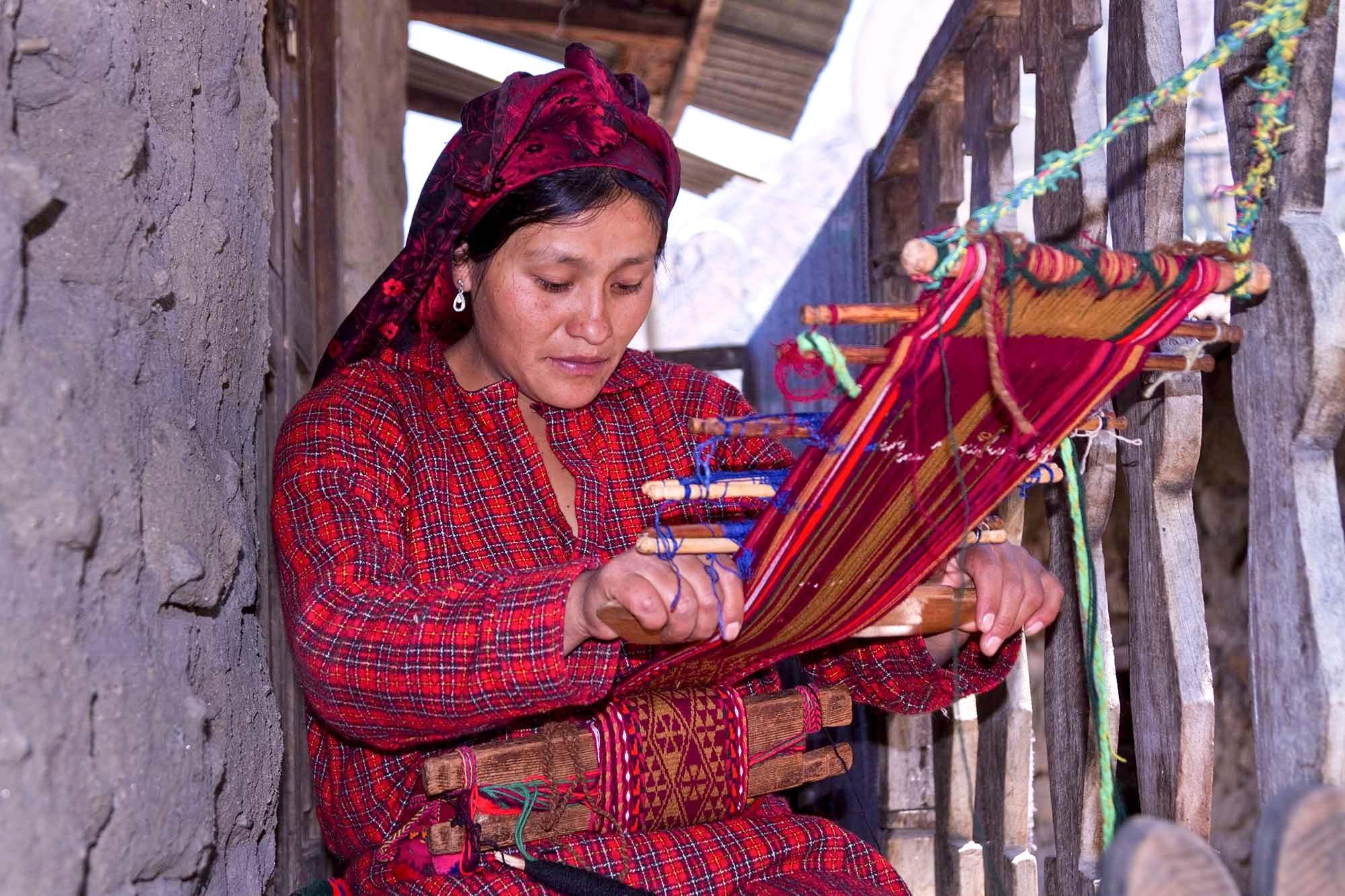 Sonia weaving a belt  wak'a
