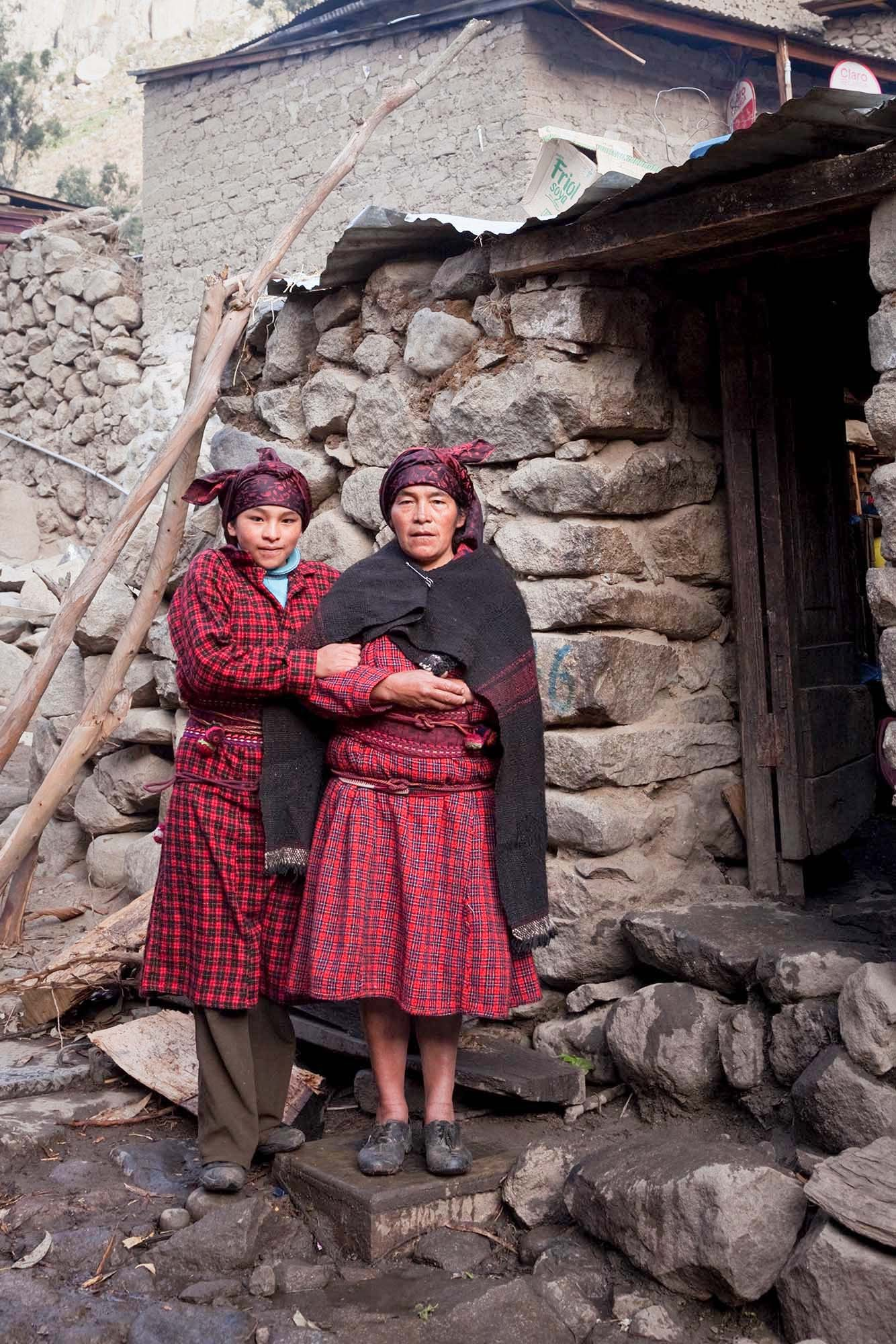 Celinda Payano, one of my photo students with her mom Clementina Valerio.   The  wincxa  is a scarf worn mainly to protect their hair from  harsh weather.  Originally it was made of thin wool but for years they  have just bought synthetic fabric.  During mourning, women change from  red and burgundy to black  wincxa .