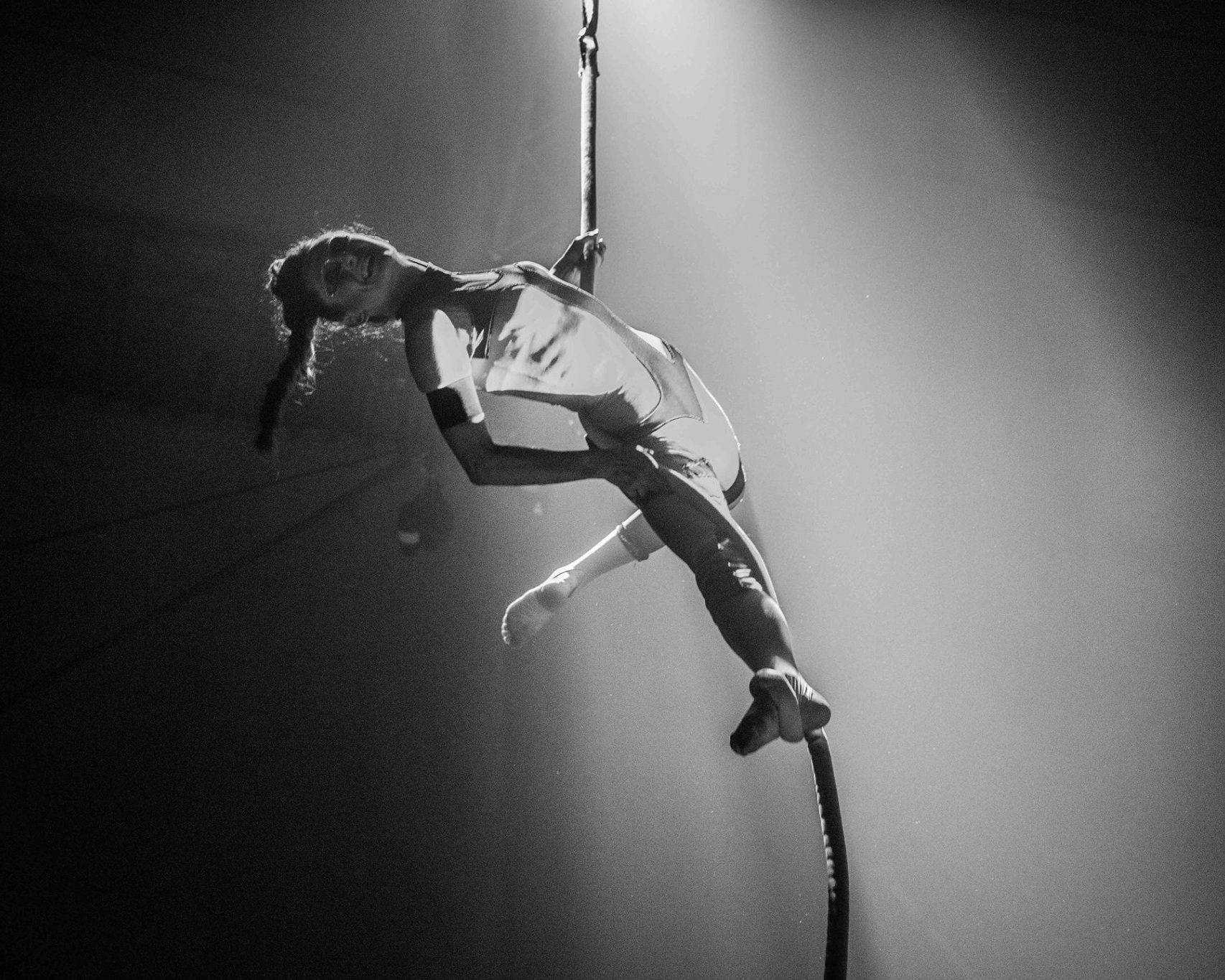 Claire Crook     is a high skill aerial performer and rigger, specialising in corde lisse, she also performs silks, static trapeze, aerial hoop, hula hoops and fire. Her background is in circus theatre and has worked internationally in contemporary circus, circus theatre, festivals, cabaret, corporate and community events.