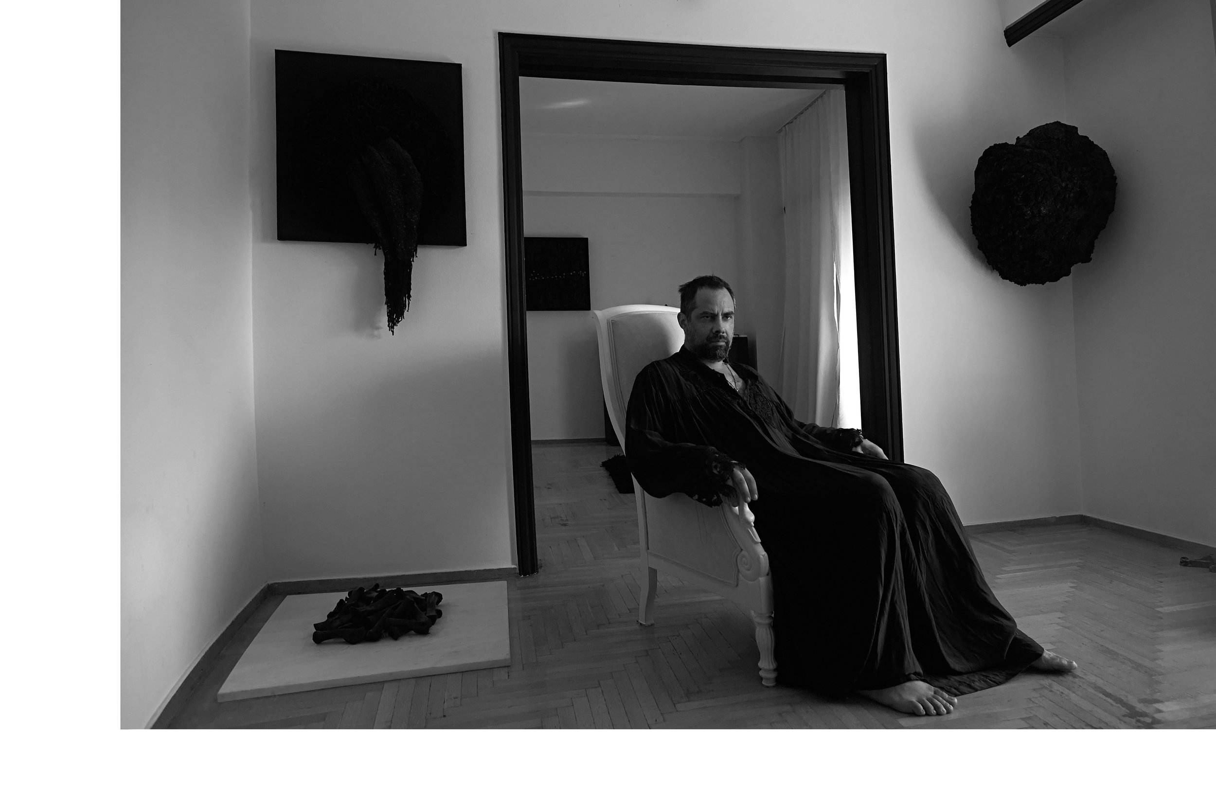 Conceptual artist Thanos Kuriakidis aka Blind Adam photographed by Christos Karantzolas at his apartment in Athens on 25 August 2018.