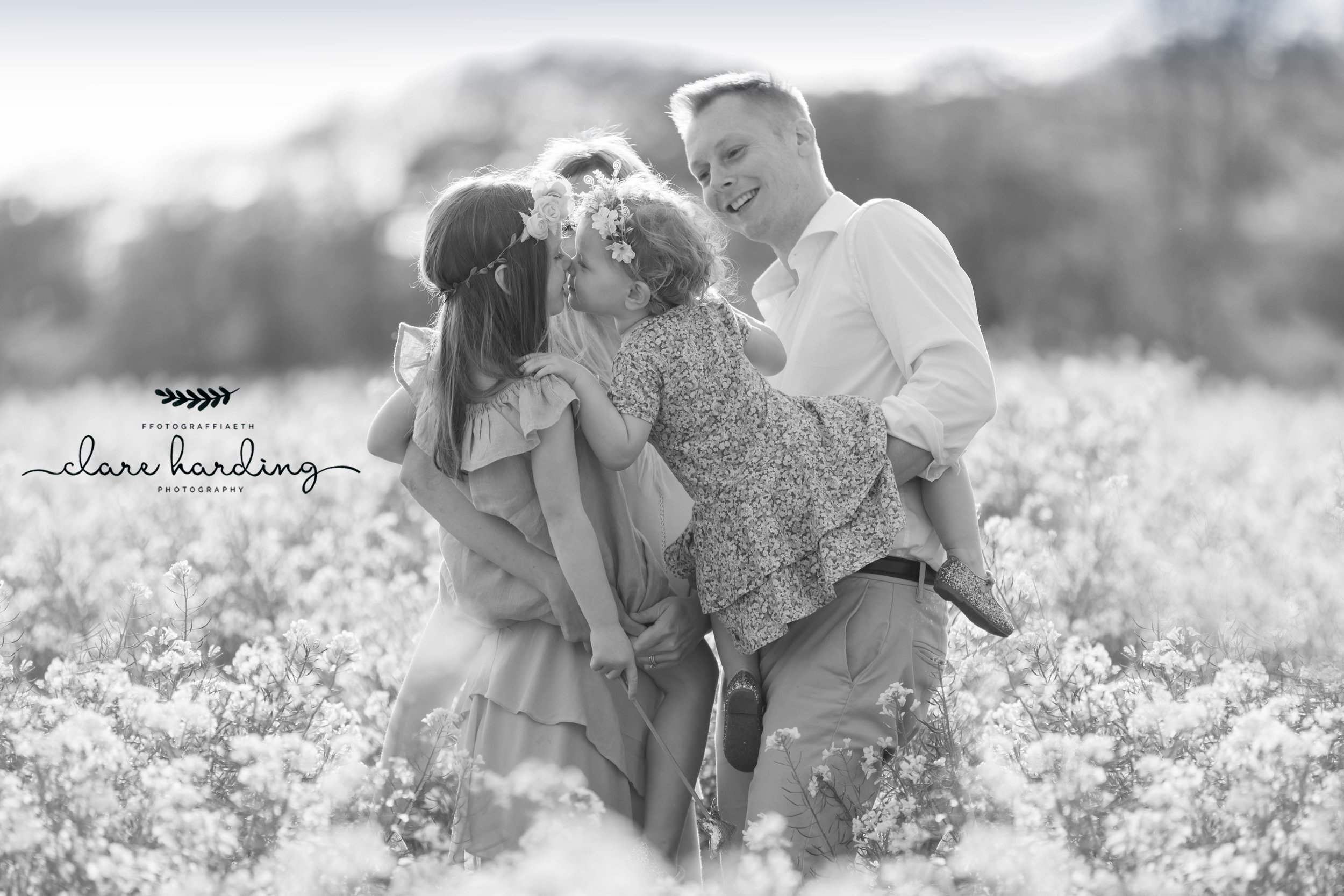 south wales photographer family in oilseed field