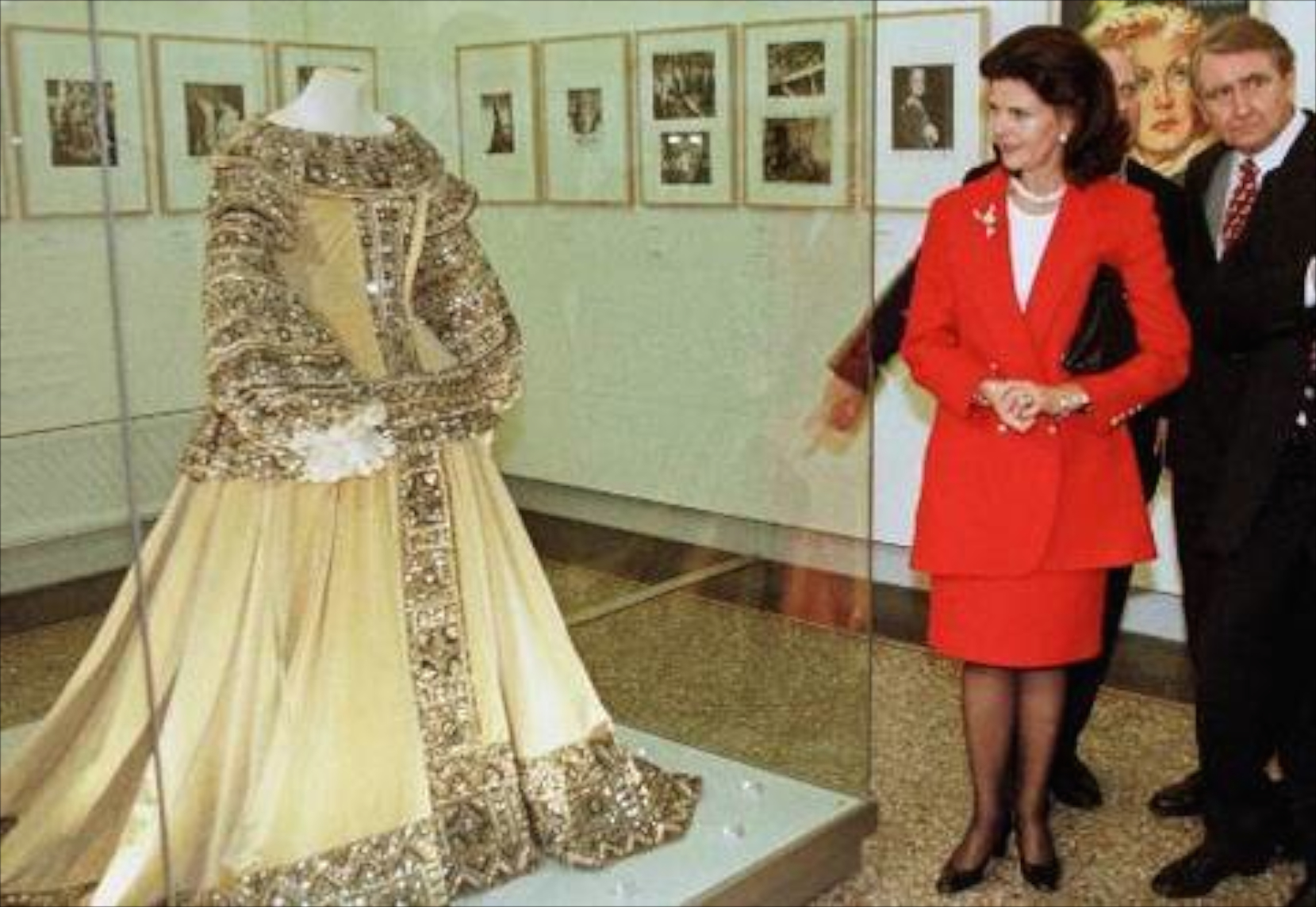 Greta Garbo gown on display while the Queen of Sweden visits the exhibit.