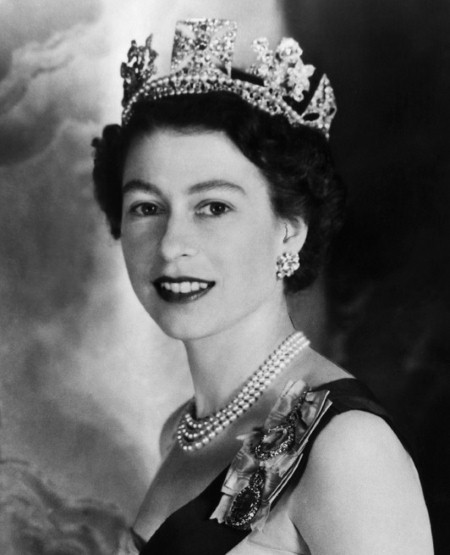 Image from Google - showing Queen Elizabeth wearing her signature triple strand pearl necklace.