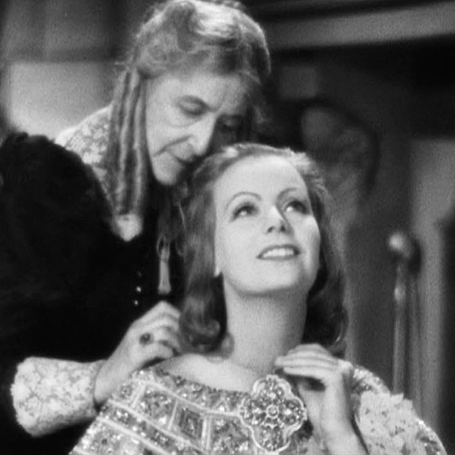 Greta Garbo getting dress and chatting with her handmaiden. This was the best image we had of the pendant.