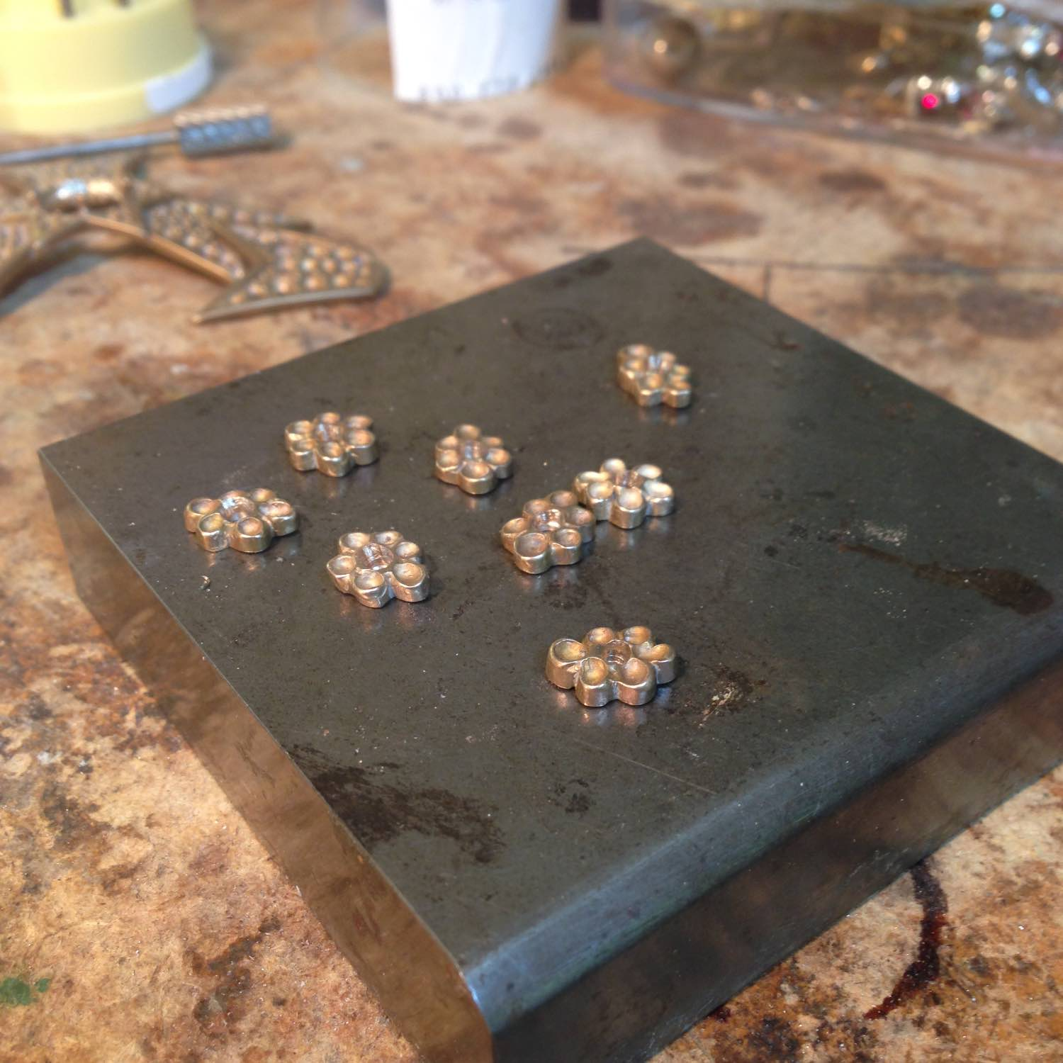 The small flowers will be set with garnets.