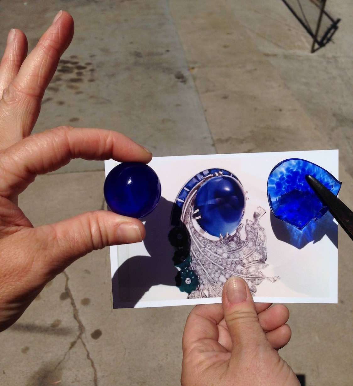 "We started with this image. We wanted the glass ""gem"" to match the sapphire in this photograph."