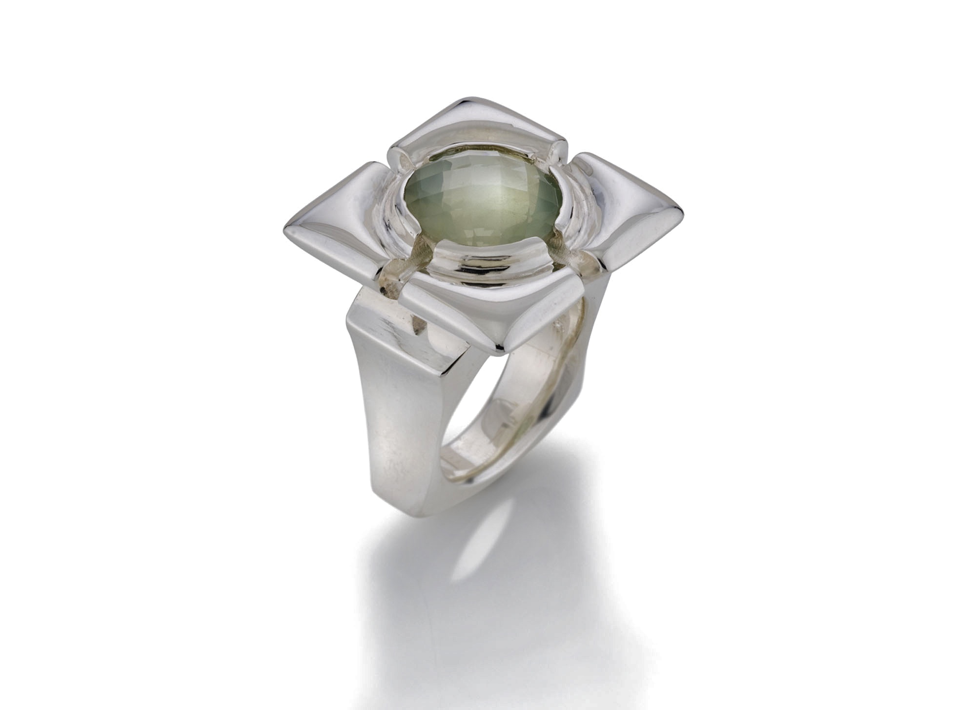 Shown here is a checker board cut moonstone cabochon, set into a sterling silver frame ring. A one of a kind design by Kathleen Lynagh Designs to highlight the gemstone's fine qualities.