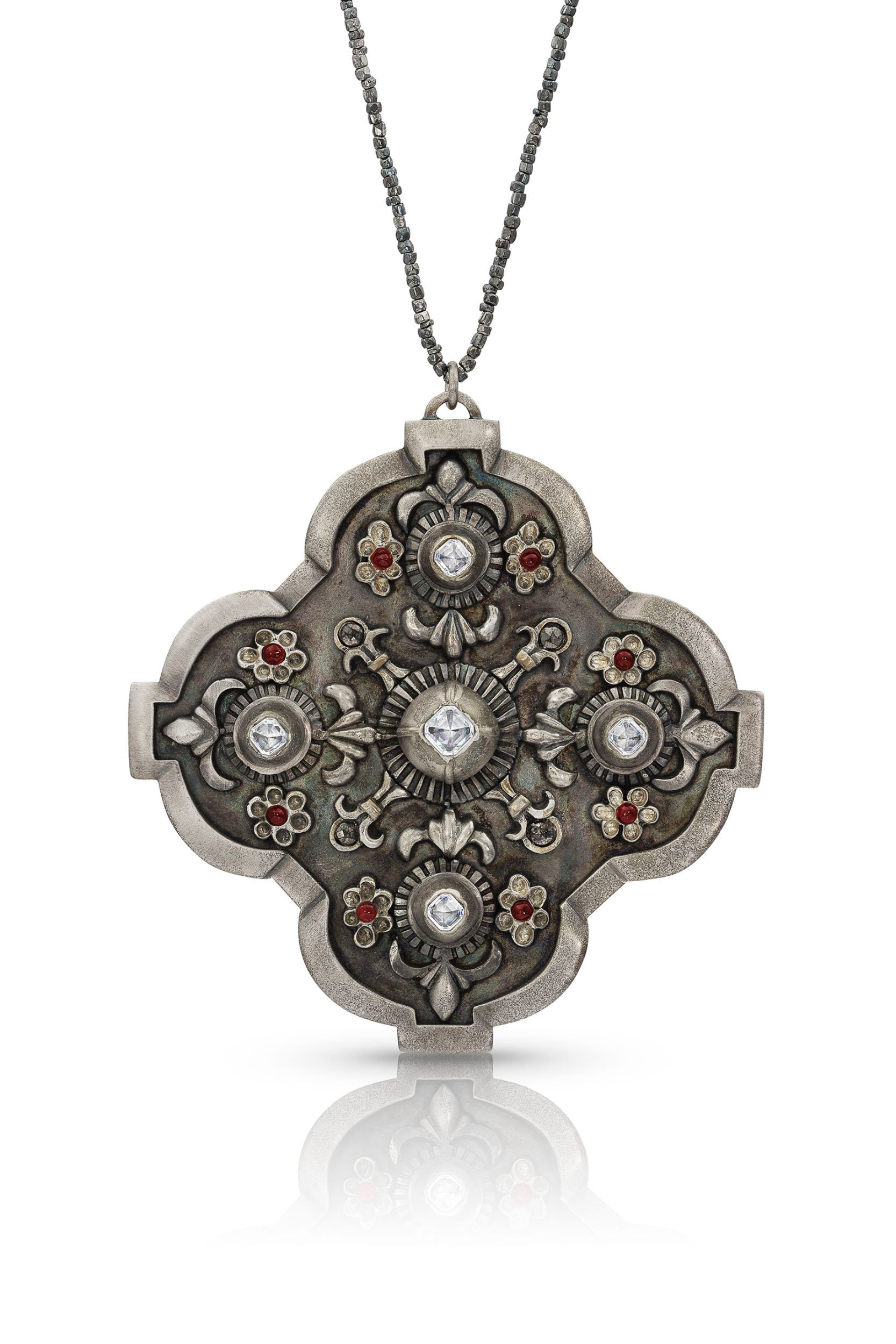Fabricated and cast pendant - made of bronze with rhodium plating, garnets and Swarovski crystals - strung on cable with hematite beads.