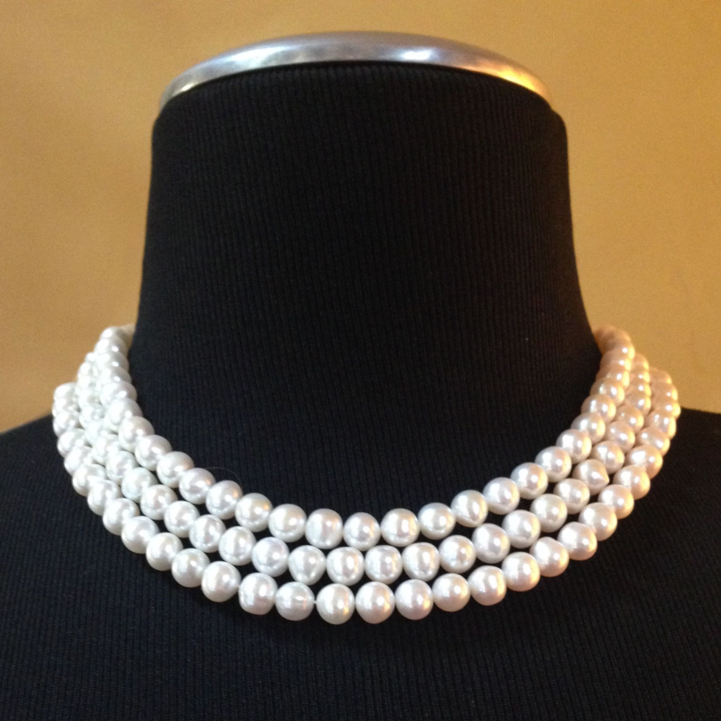 Custom made triple strand pearl necklace, strung on silk and finished with a silver clasp. Custom orders welcomed.