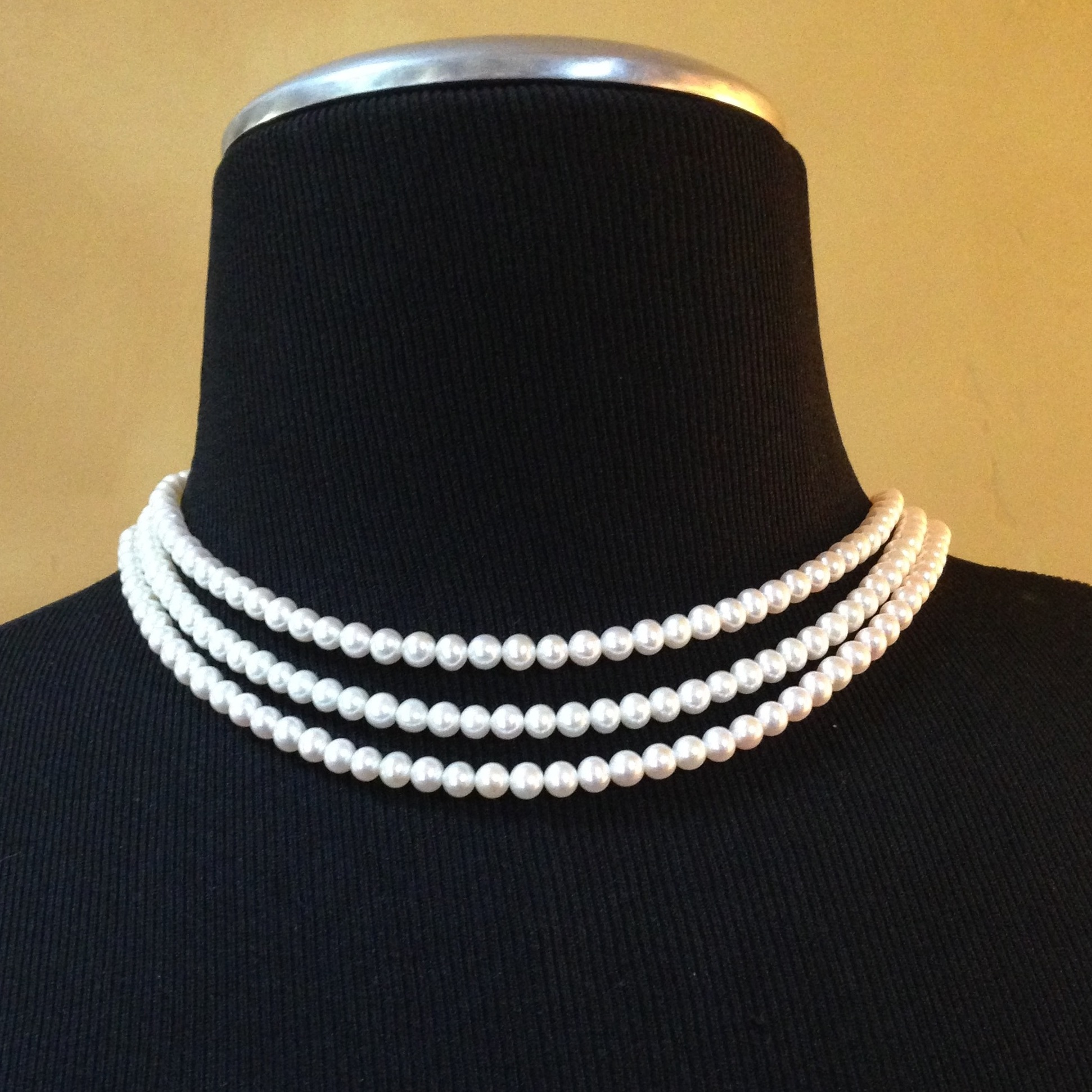 Smaller pearl version of the same classic design - triple strands 5.5mm freshwater pearls - Kathleen Lynagh Designs. Please contact us thru our site for your custom jewelry order.