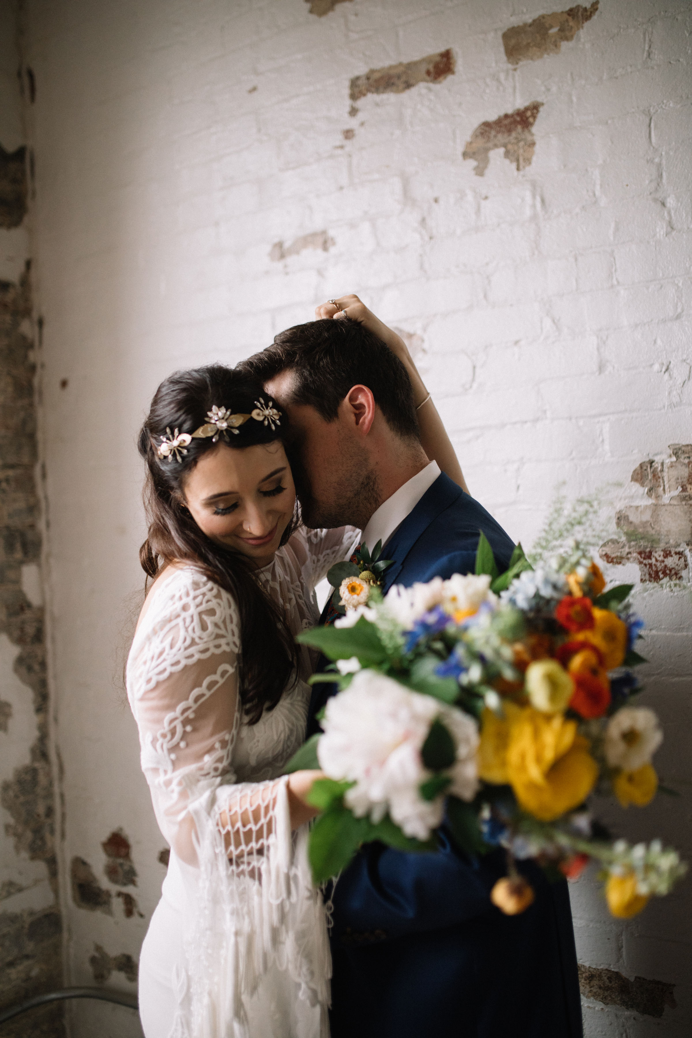 Boho Wedding with a Bride in a Backless Dress and Bespoke Tilly Thomas Lux Headpiece