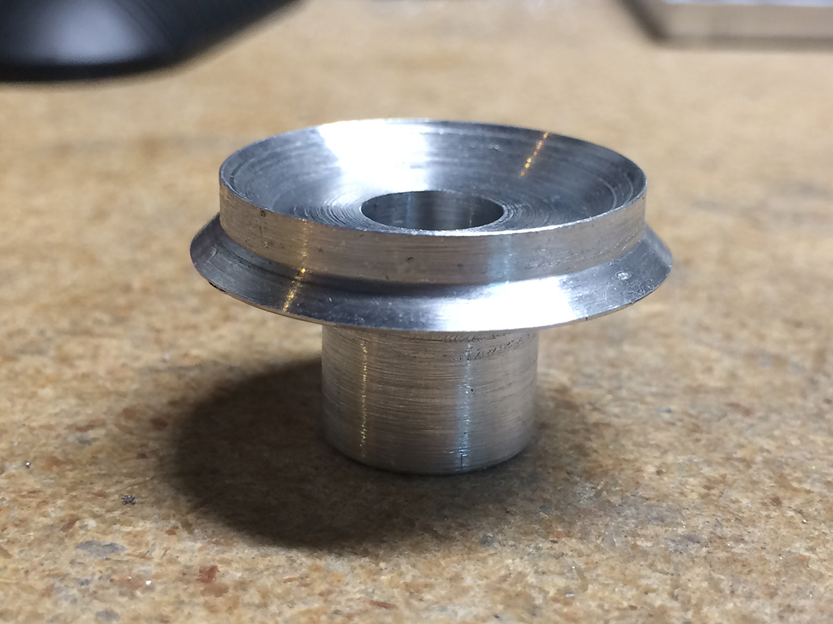 Rear barrel mounting flange