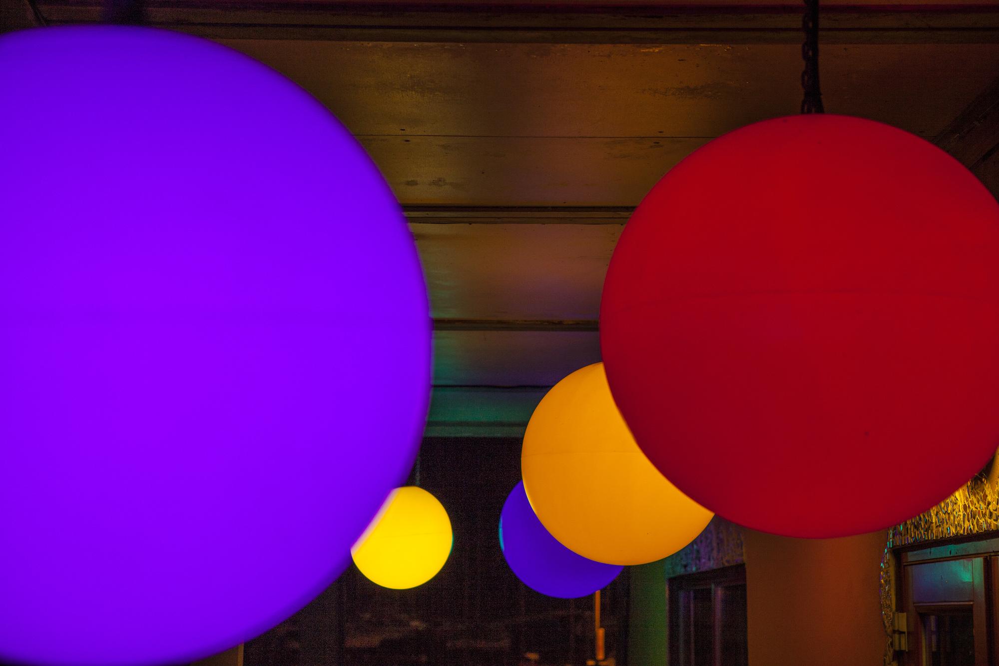 eleanor-bell-river-restaurant-lighting-colour-changing-pendants.jpg