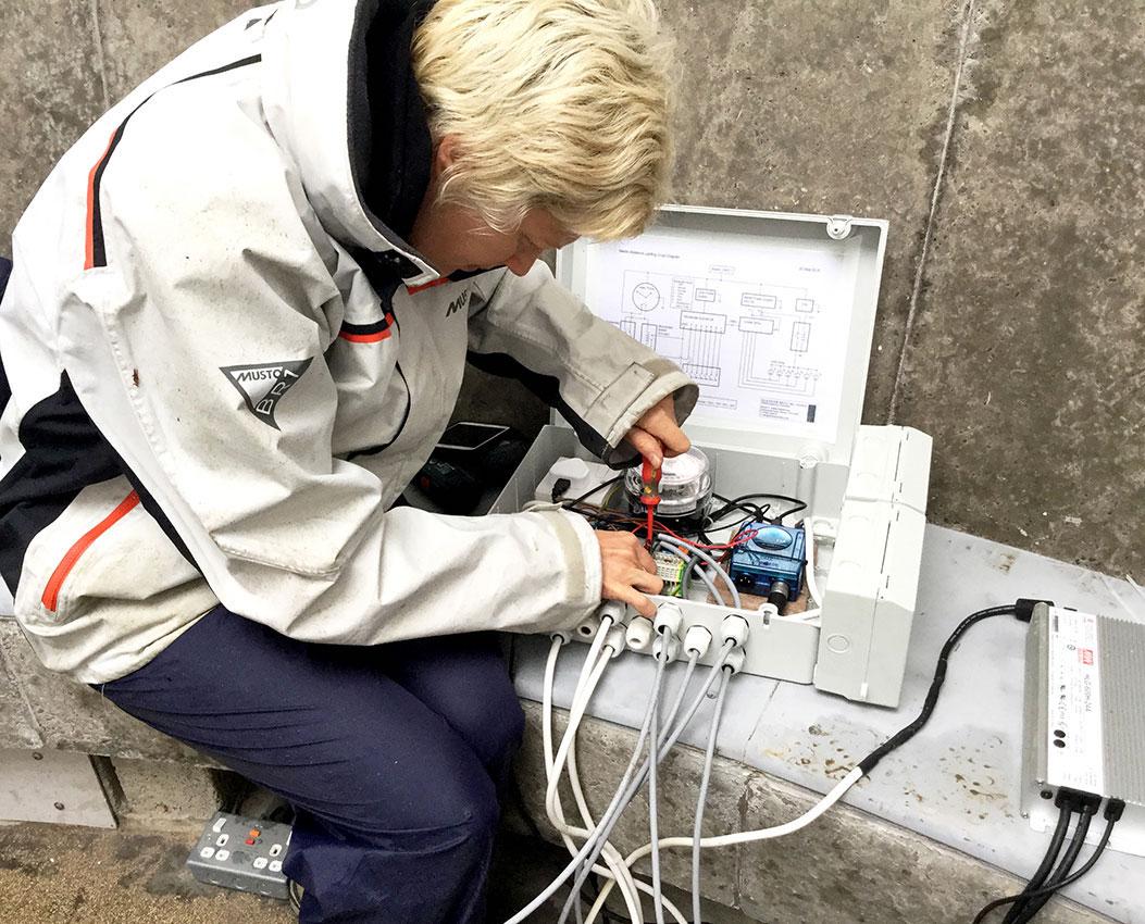 Eleanor Bell, installing lighting for James Turrell Skyspace, Kielder