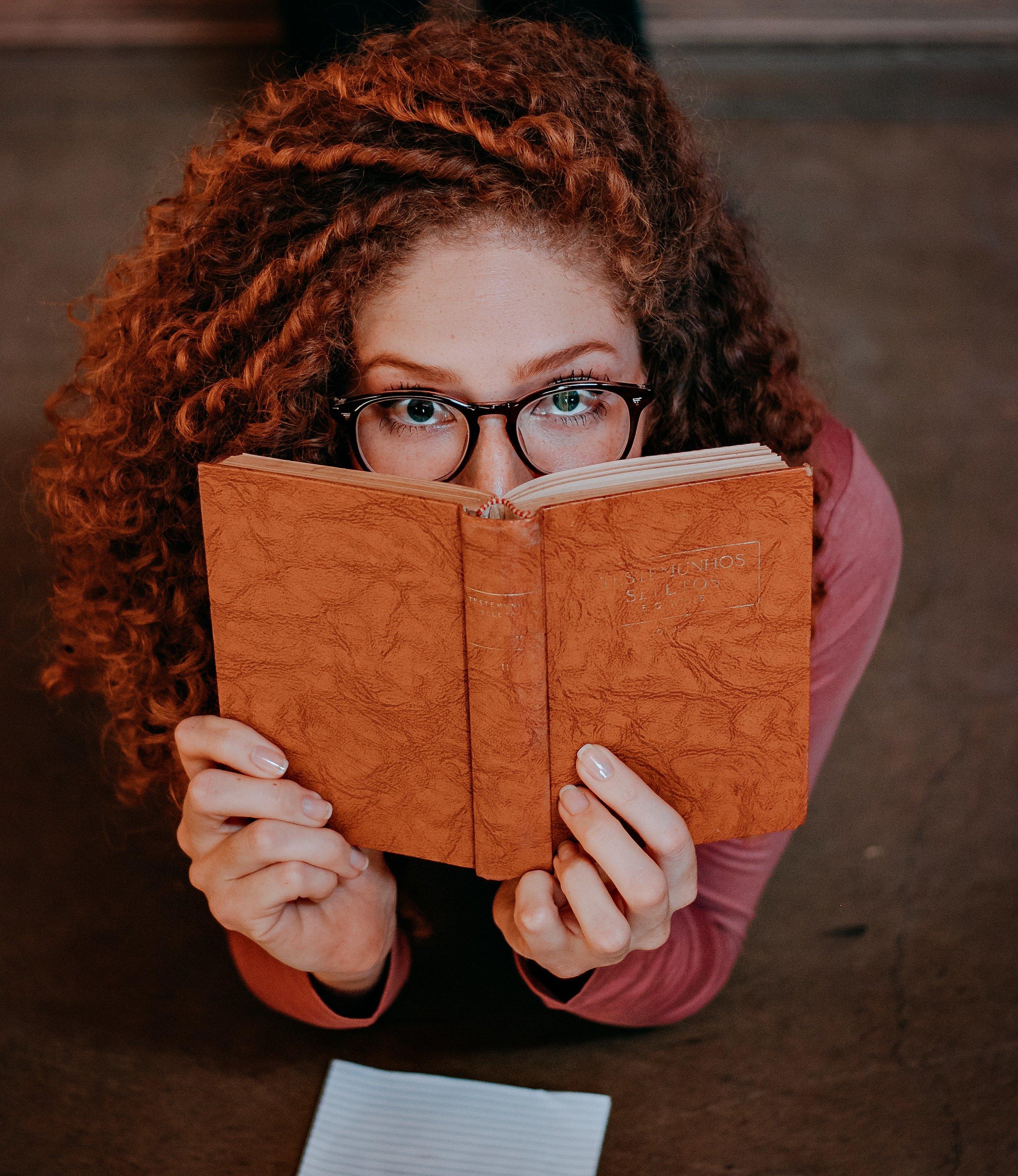 book-close-up-curly-hair-1865328.jpg