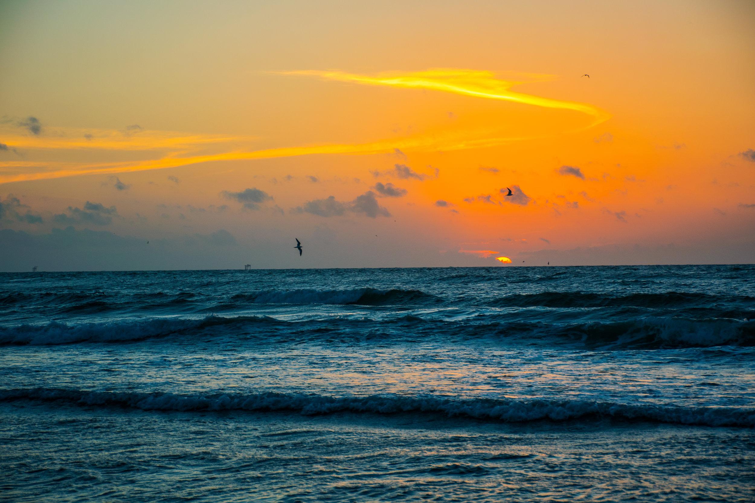 iStock-Sunrise Over Waves Crashing on Beach478831502.jpg