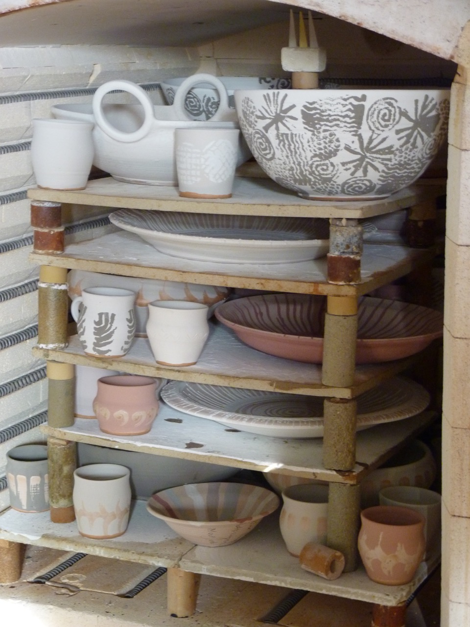A kiln packed to the brim with unglazed ceramics by Konstanze Harms.